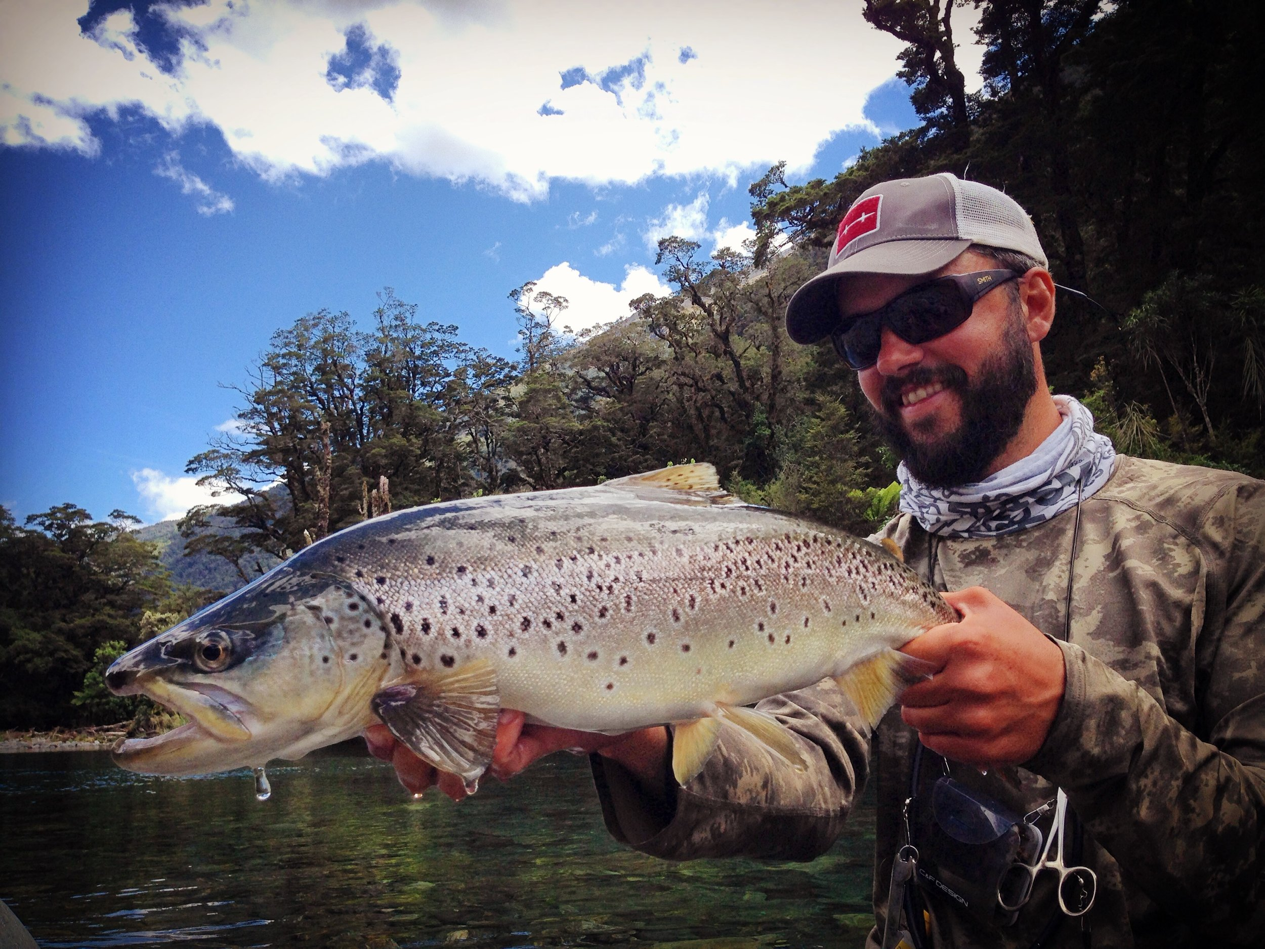 New Zealand fly fishing guide Jeff Forsee with a big backcountry brown trout.