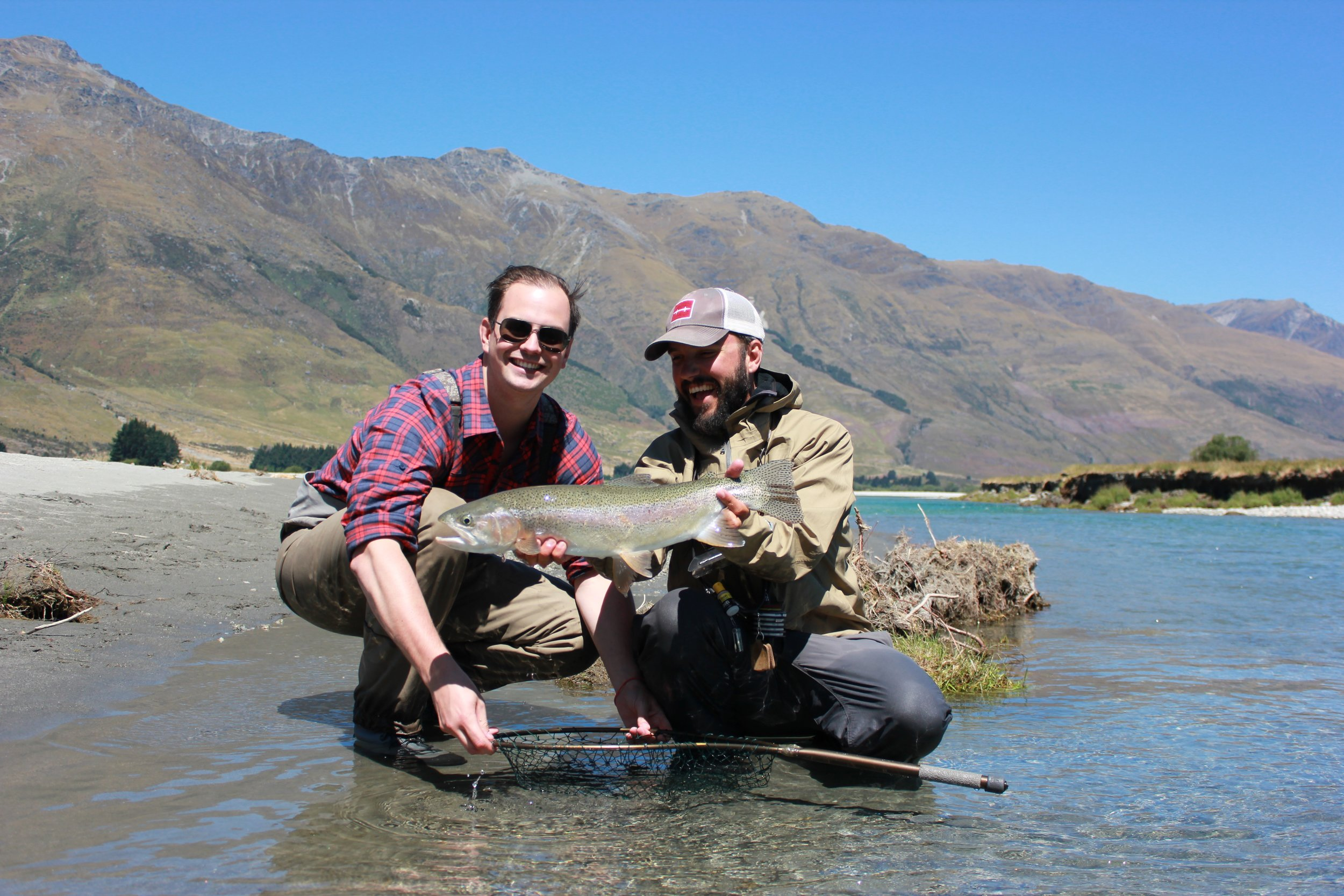 New Zealand fly fishing guide Jeff Forsee with a happy angler