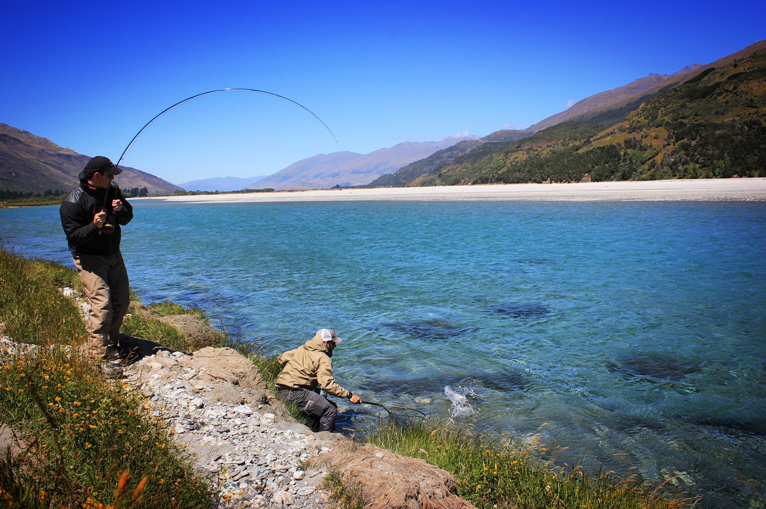 Wanaka, New Zealand fly fishing guide Jeff Forsee netting a fish!