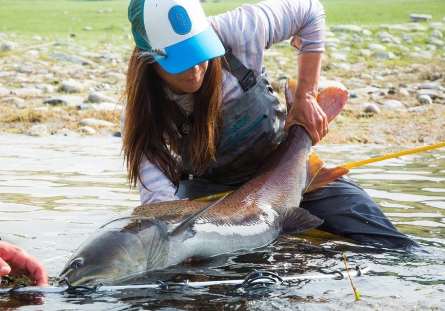 Patagonia ambassador April Vokey with a giant mongolian taimen