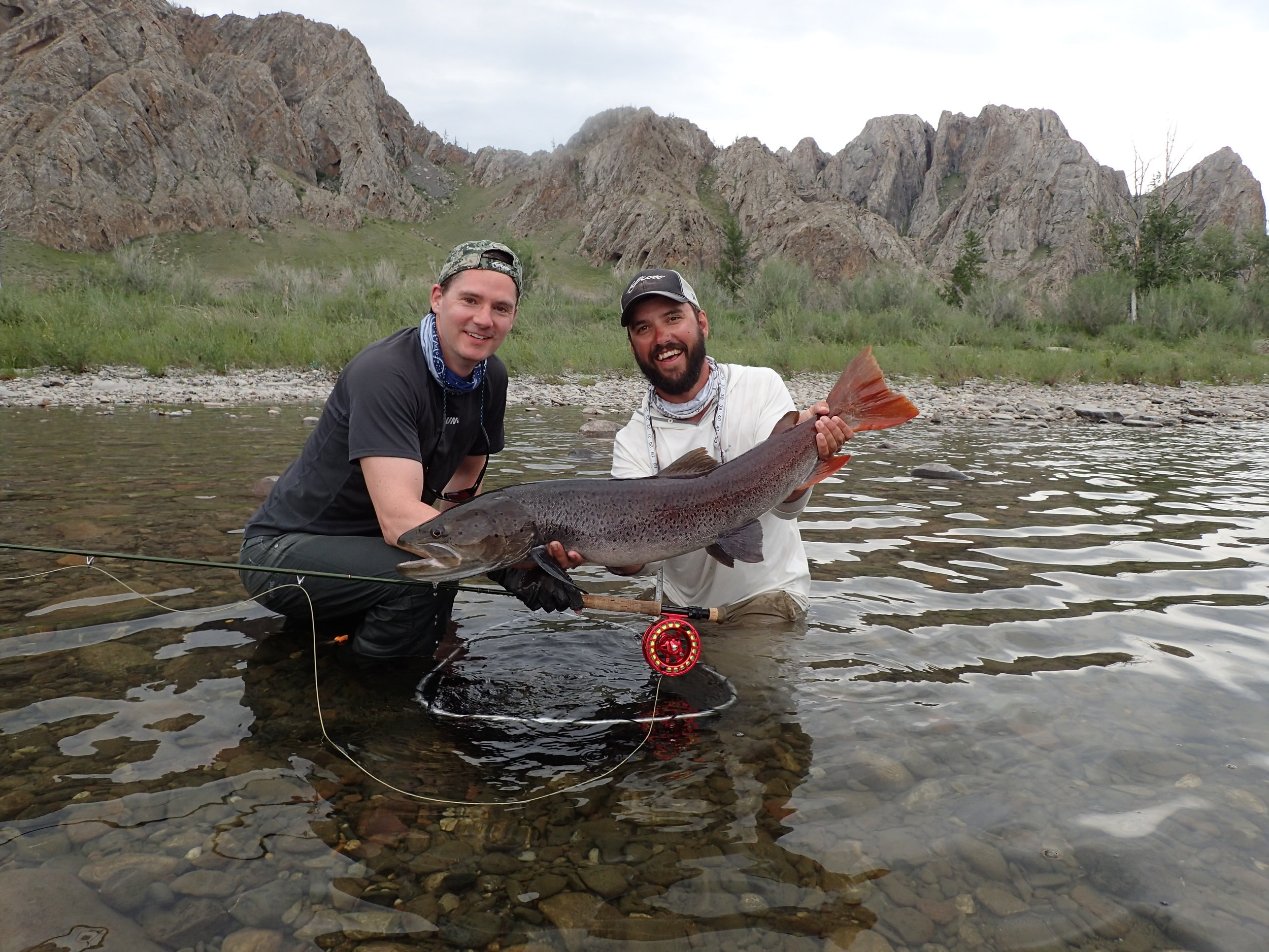 Fly fishing guide Jeff Forsee with a big taimen in Mongolia.