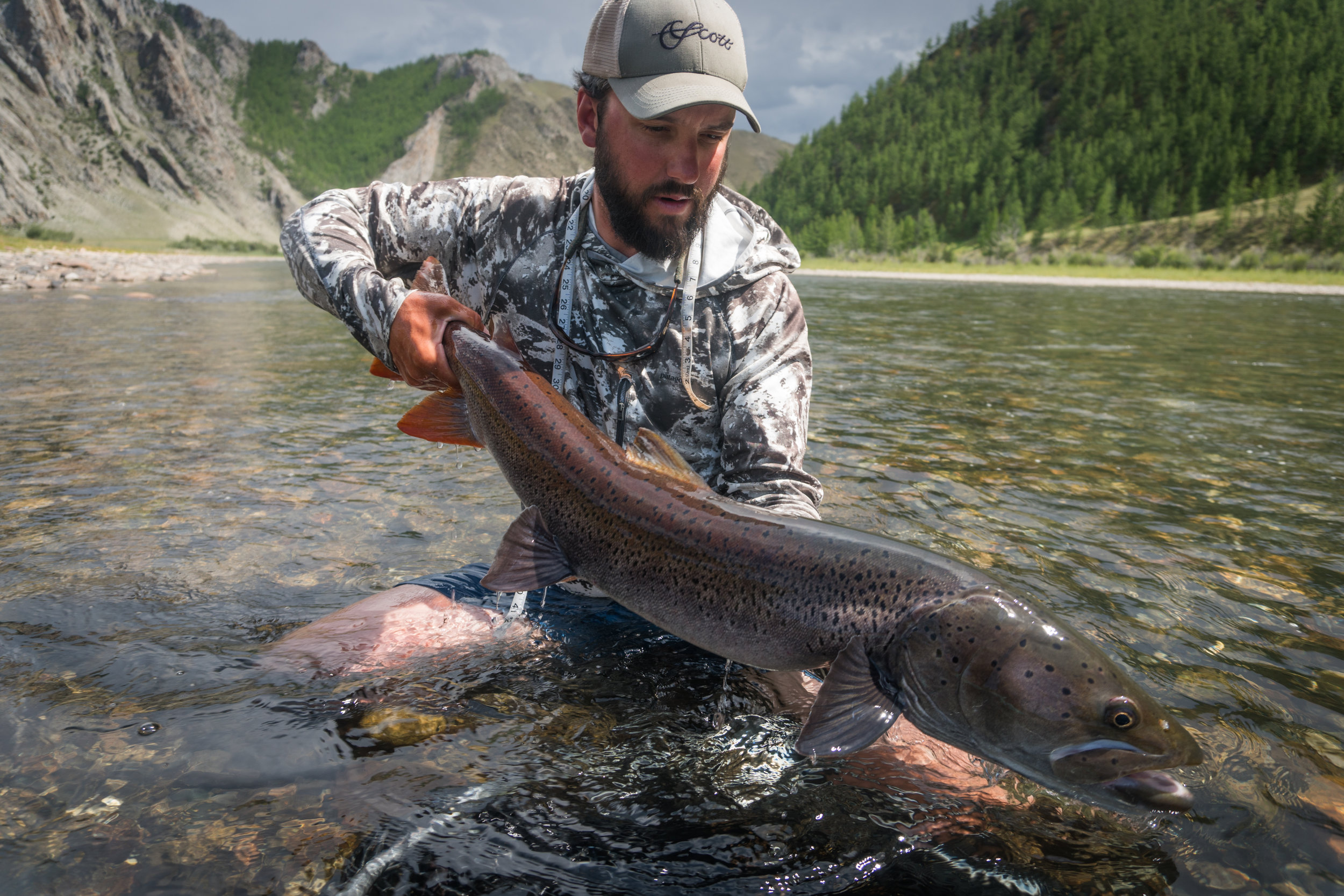 Fly fishing guide Jeff Forsee with a large Mongolian taimen