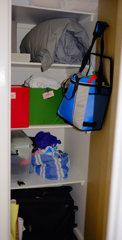 disorganised storage cupboard