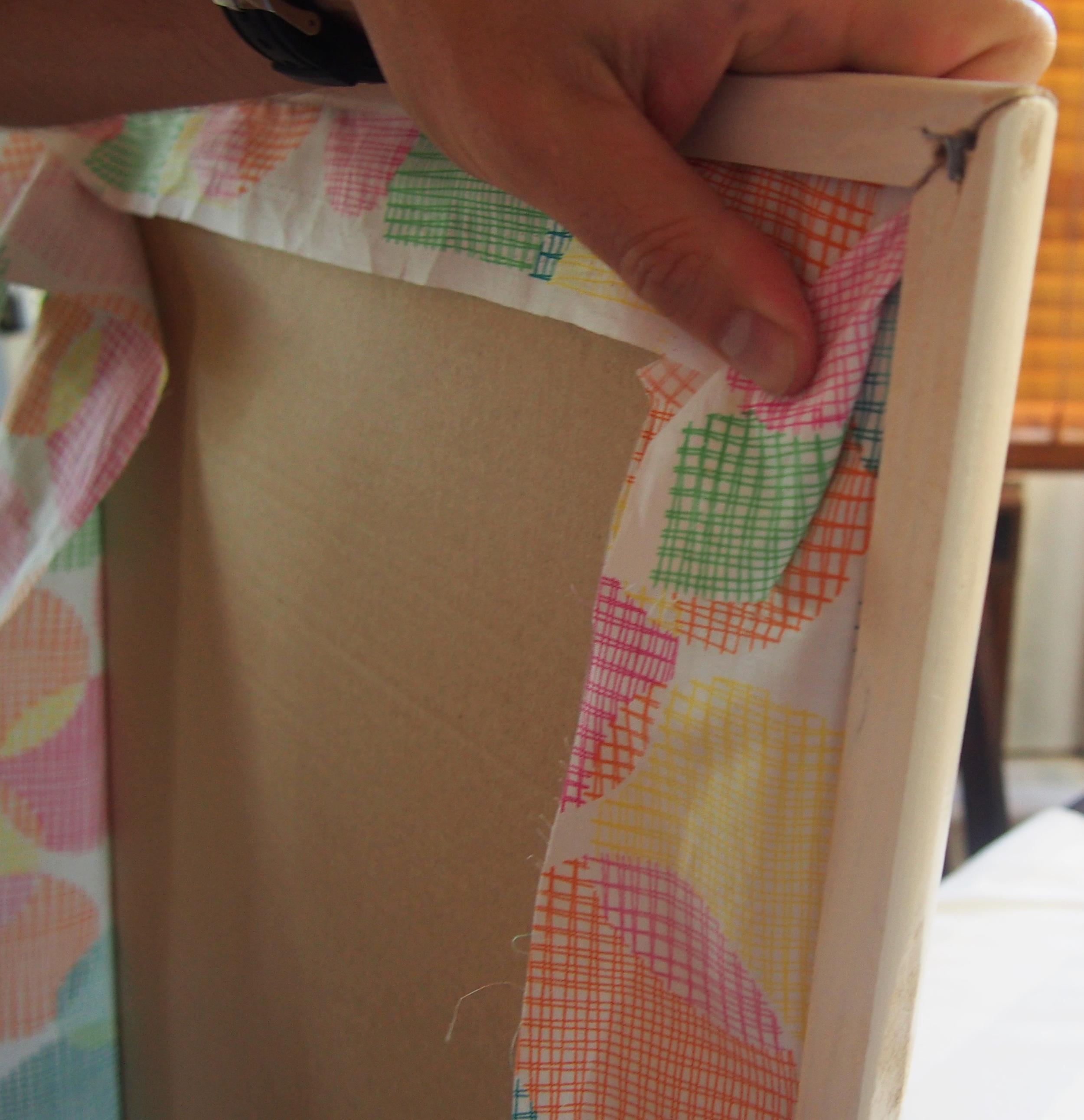 pinning material corners onto cork board