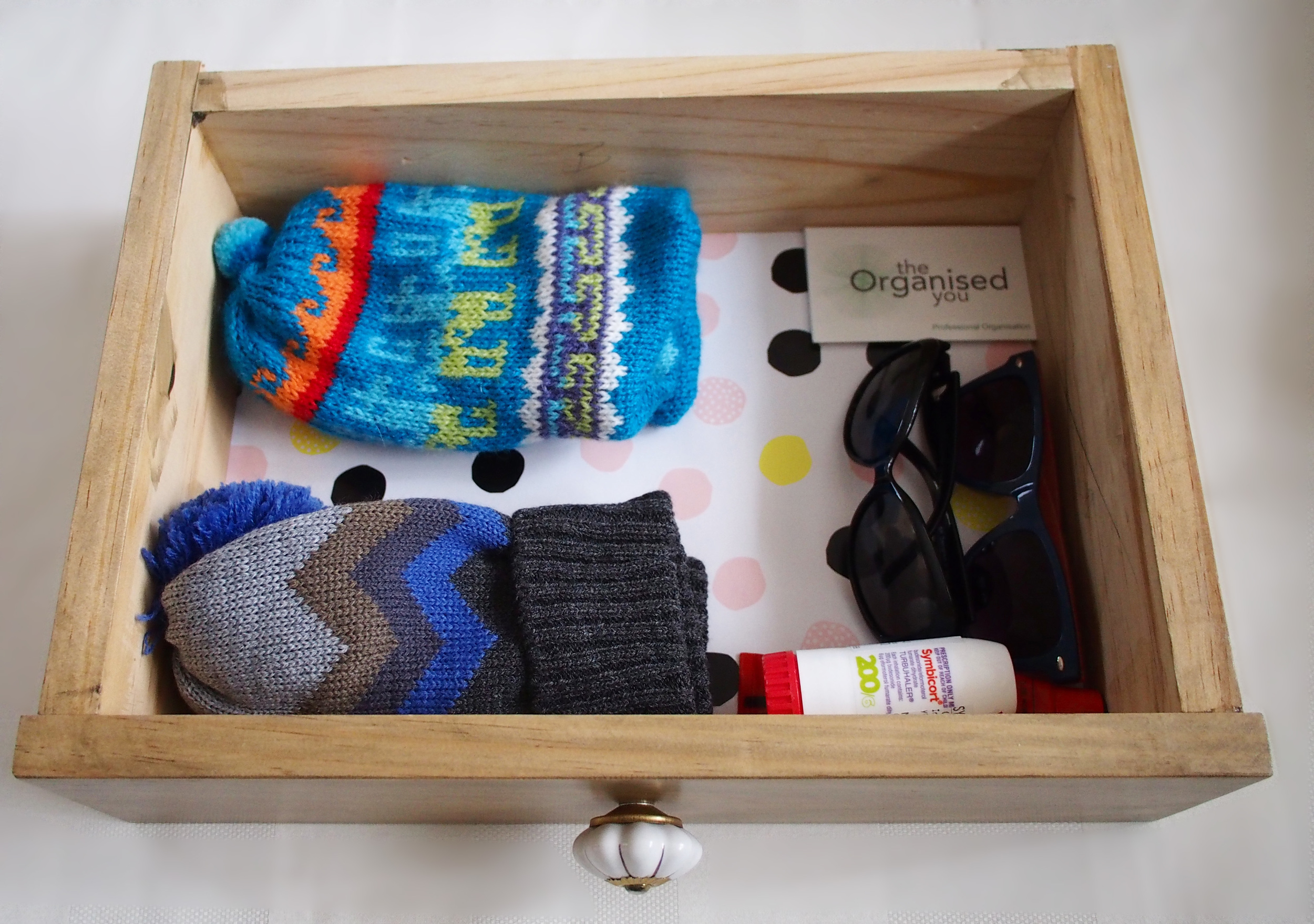 drawer containing kids supplies