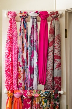 organising scarves using a rail on the back of a door