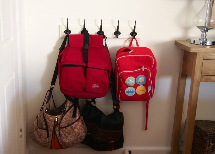 bags on hooks in entryway