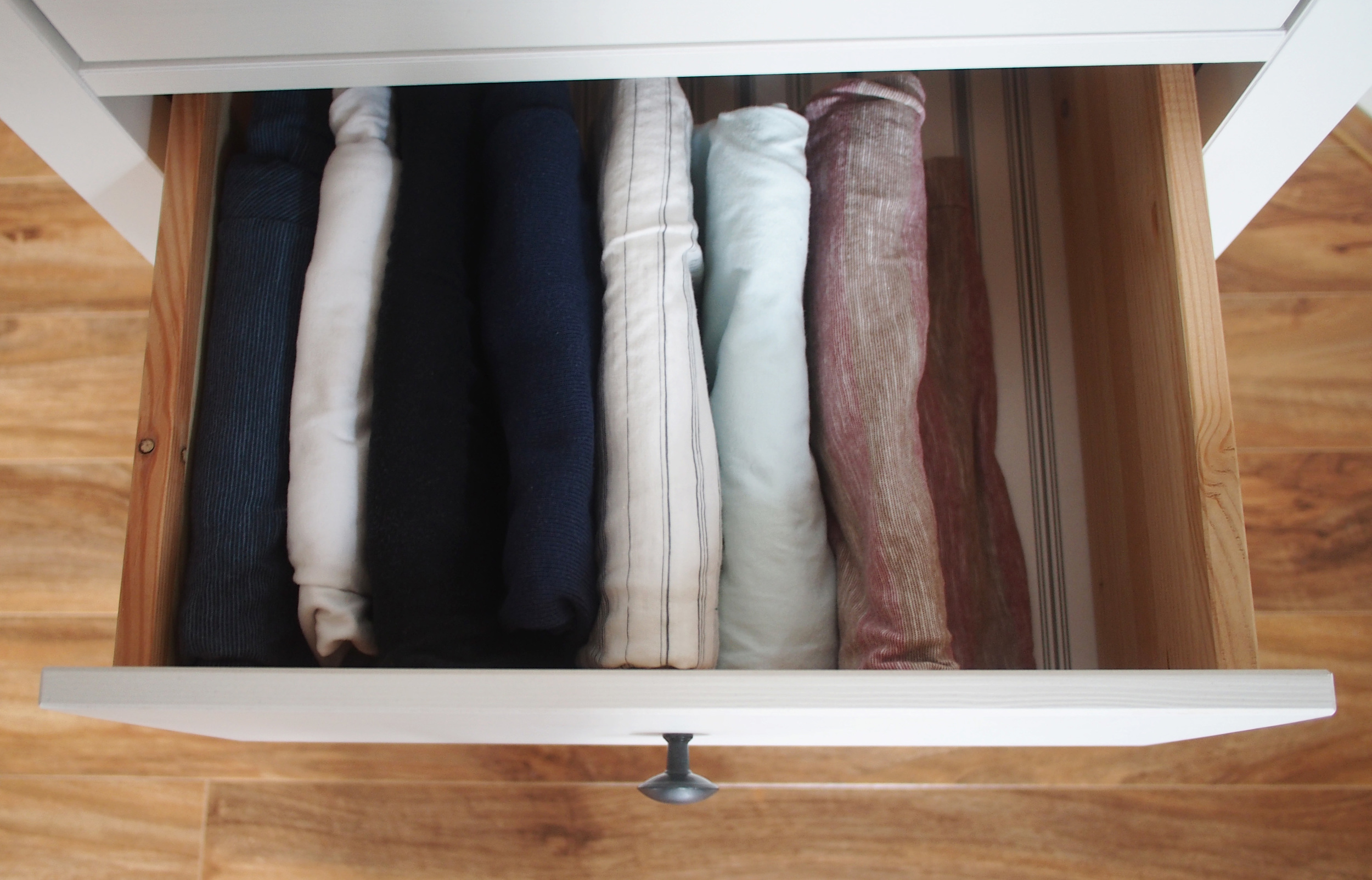 storage solutions - filing tops horizontally for increased storage in dresser drawers