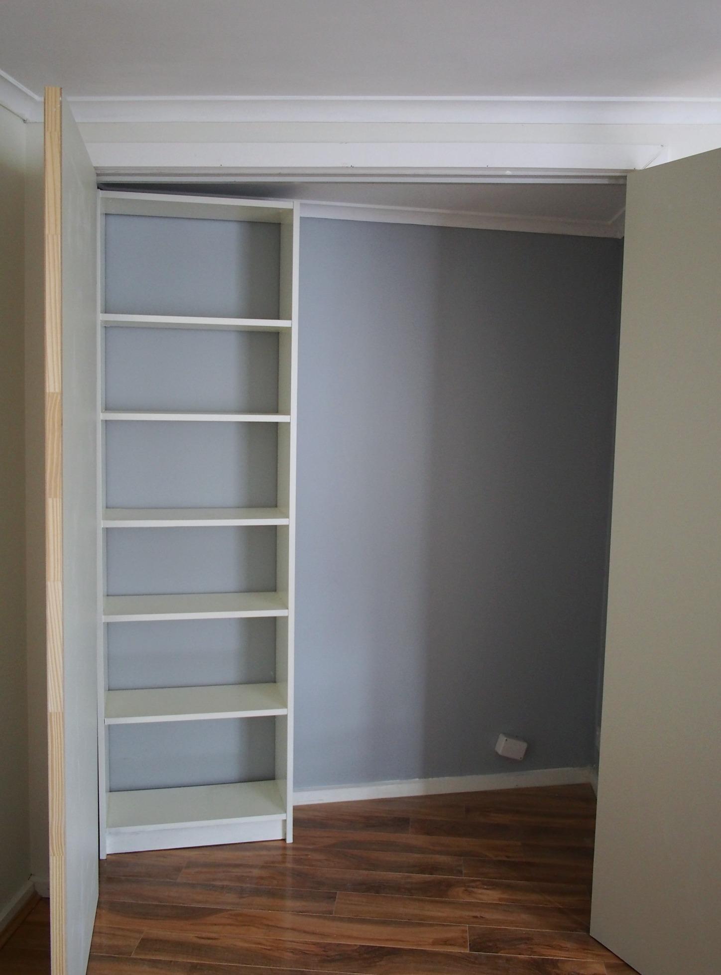 Billy bookcase in storage cupboard