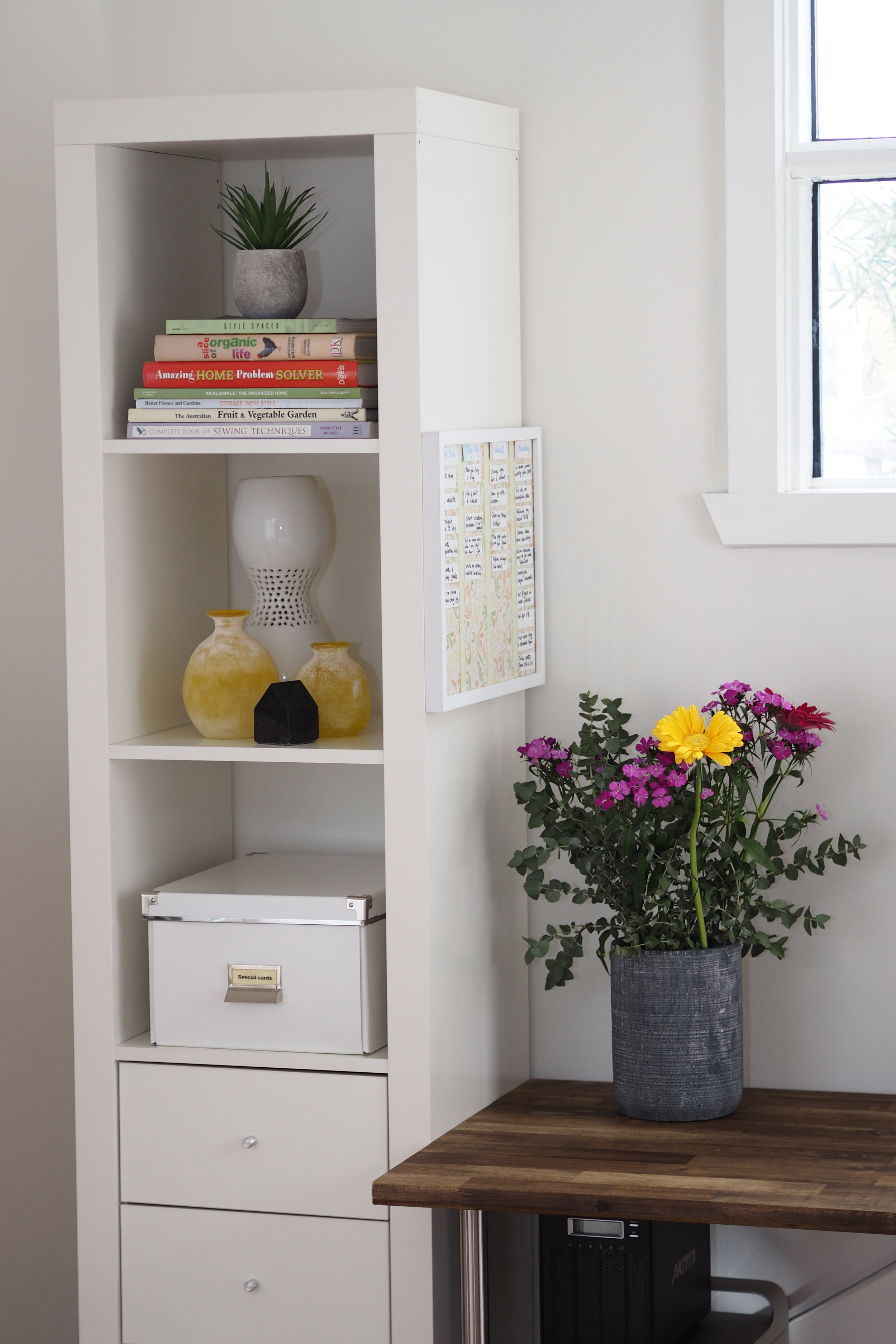 Ikea Expedit units ( similar here );  Ikea storage boxes;  all decorative items from  Deja Vu Interior
