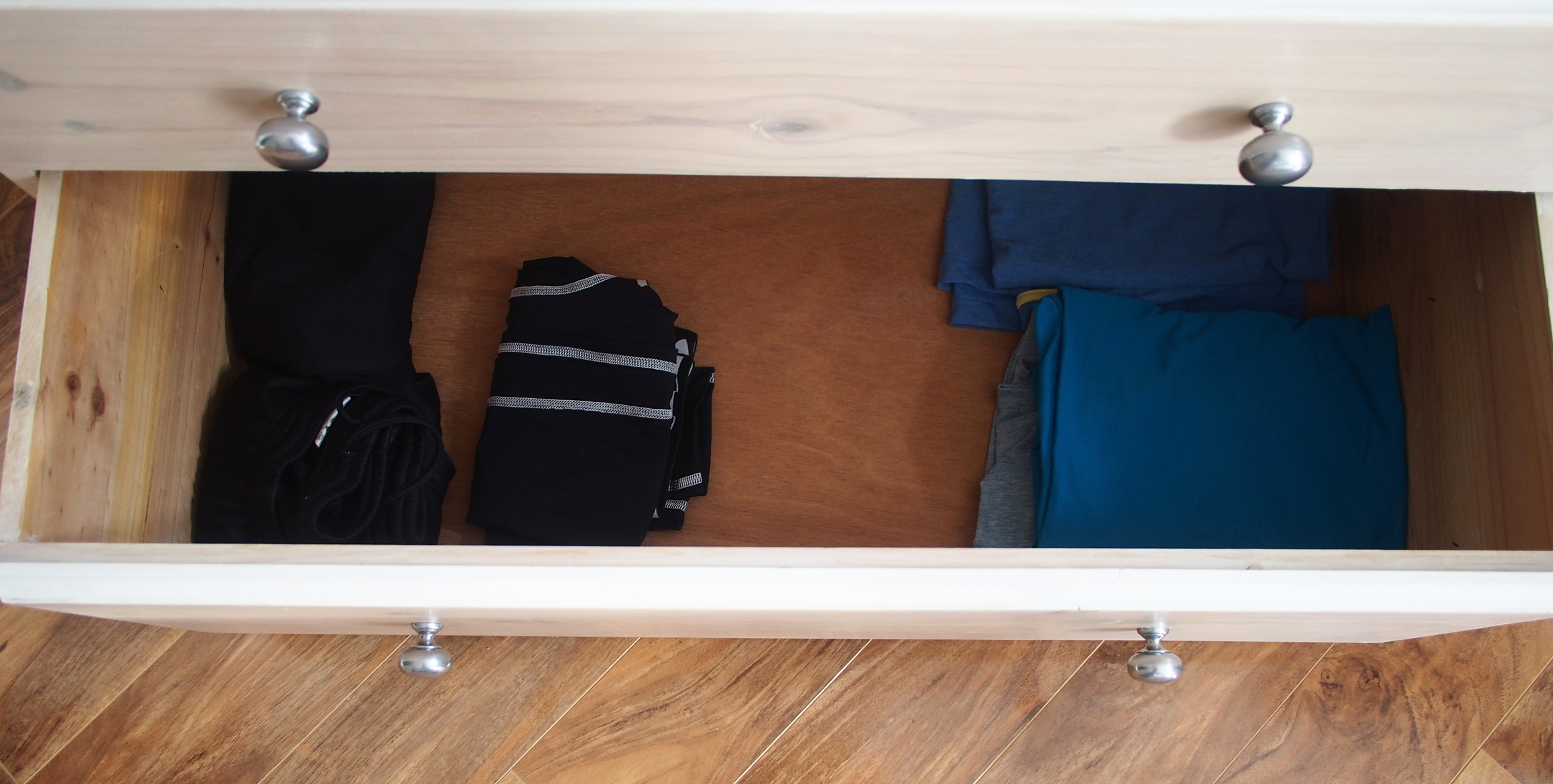organising clothes in chest of drawers