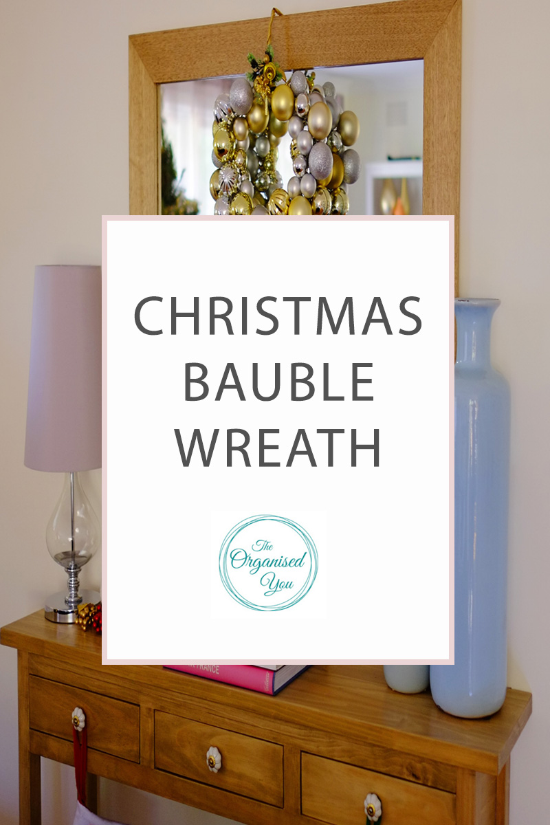 DIY Christmas Bauble Wreath - do you like to get creative at Christmas time and make decorations for your home? I show you how to make a fun and easy bauble wreath, which is inexpensive and really adds to your Christmas decor. Click through to read the full tutorial.