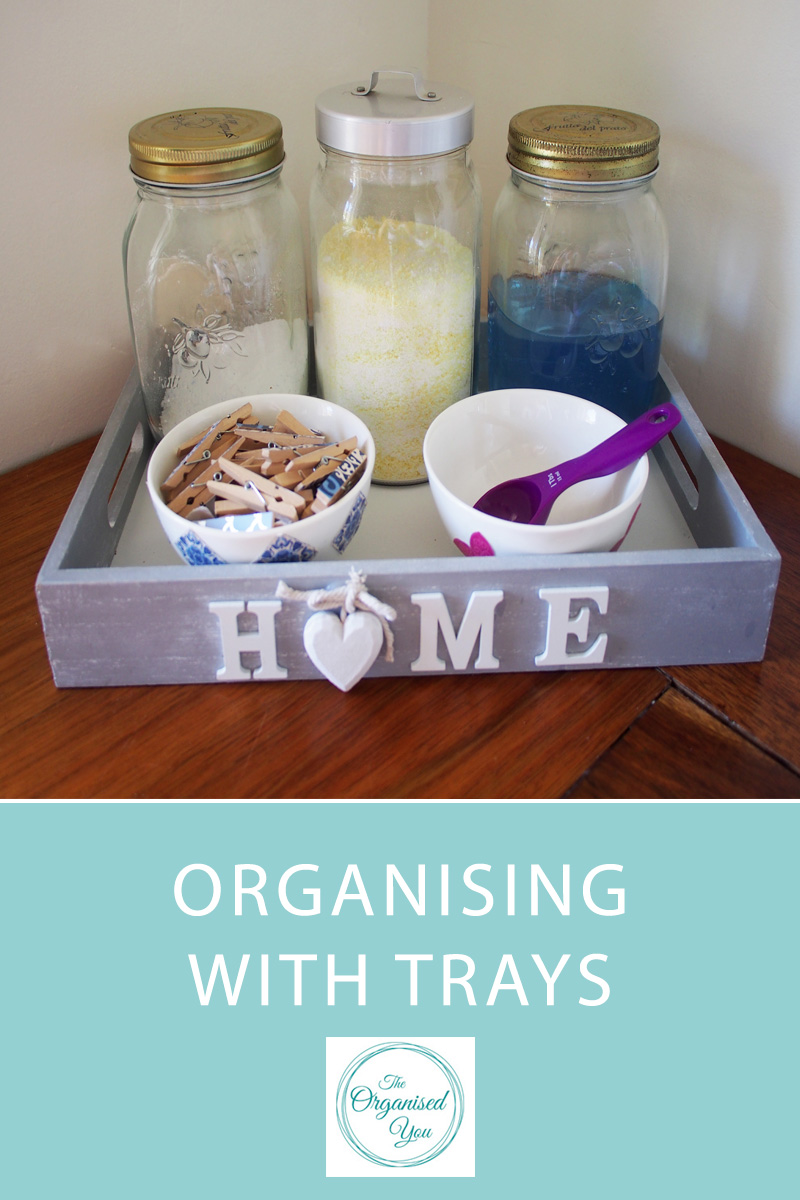 Organising with Trays - trays are a fantastic and stylish storage solution around the home. They can be used to corral groups of items, such as laundry supplies, perfume, jewellery...the options are endless! Click through to see how I have used them throughout our home to keep organised