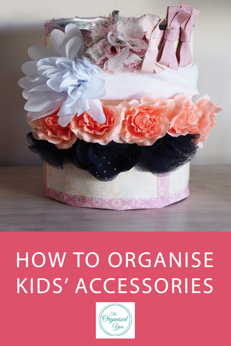 How to Organise Kids' Accessories - having an organised system for your kids' accessories, such as girls' headbands, clips, hair-ties and jewellery, will make getting ready in the morning a lot easier and quicker. Having an organised system also set up for storing hats and bags will make your life much easier, rather than having them all thrown in a box together. Click through to read the full post for ideas on organising kids' accessories!