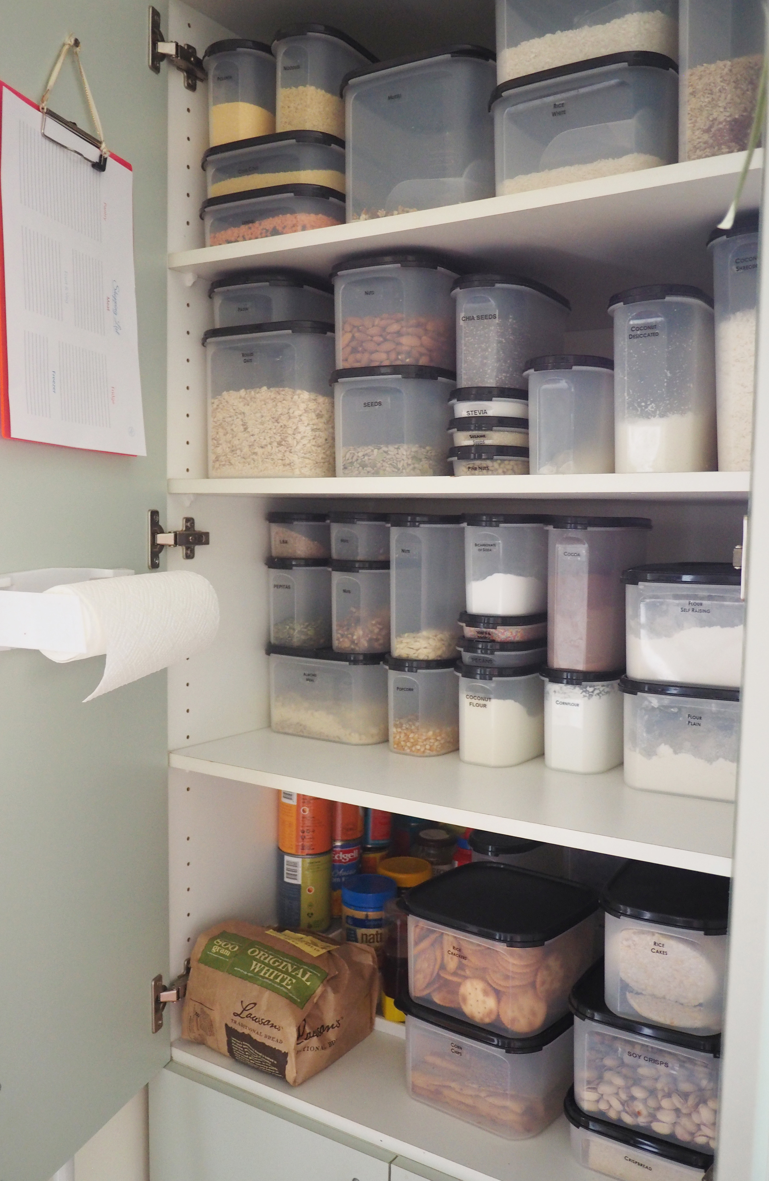 An organised pantry using air-tight containers to store food items according to type and create an easy-to-use, accessible, neat and organised pantry