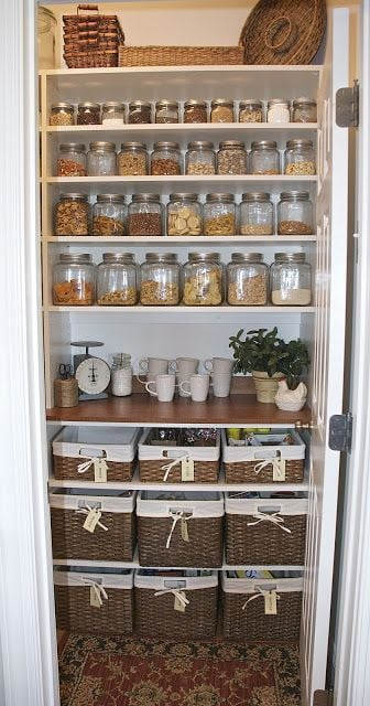 Baskets and jars in an organised pantry