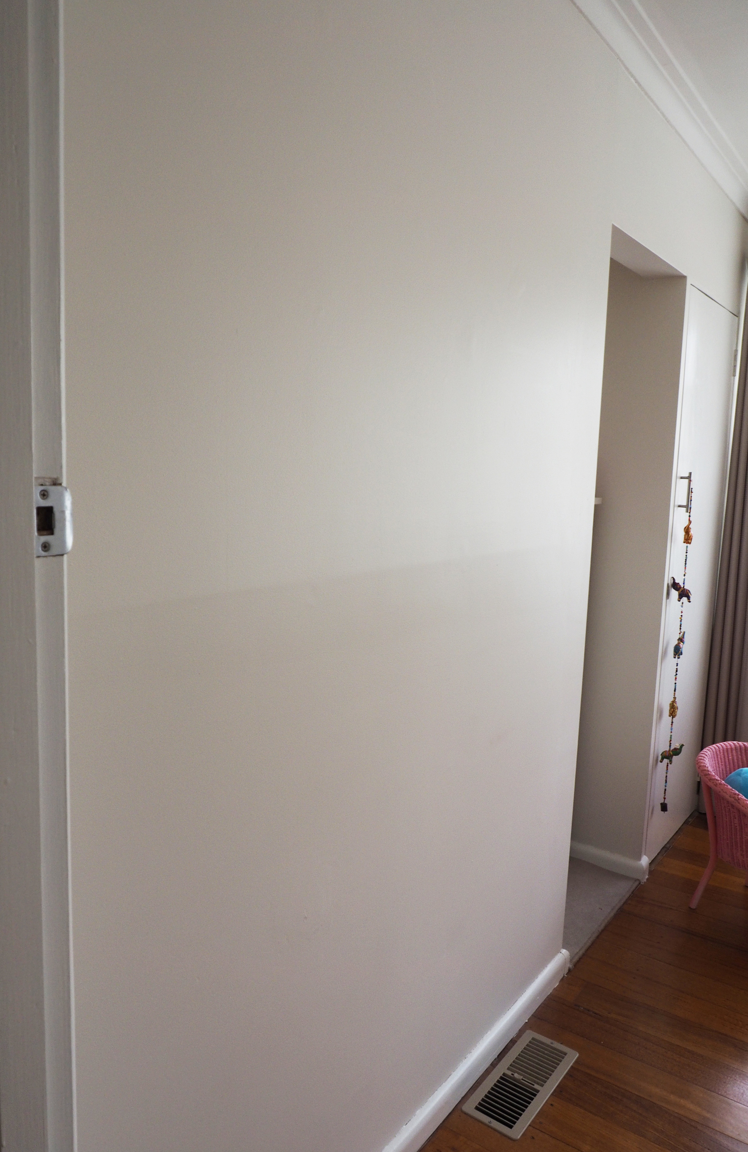 A blank wall in the bedroom is the perfect spot for creating a child's artwork display