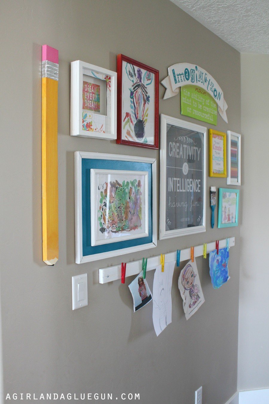 A board with pegs attached is an easy and effective way to display artwork in a child's bedroom
