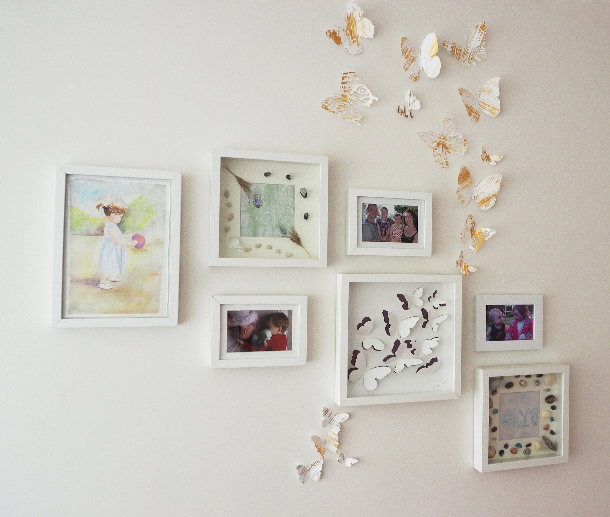Photo gallery wall for a child's bedroom - paintings, pictures and photos to add a personal touch to a child's bedroom