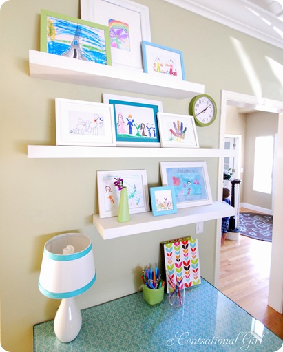Gallery shelves are the perfect place to display framed artwork