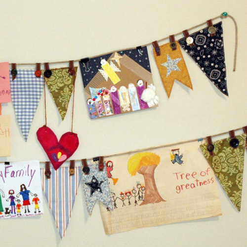 A gorgeous bunting display of artwork and fabric