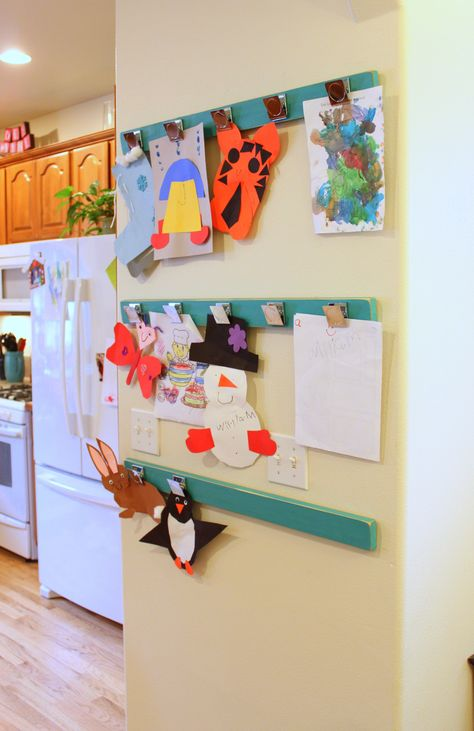 Painted boards with magnetized clips to display artwork