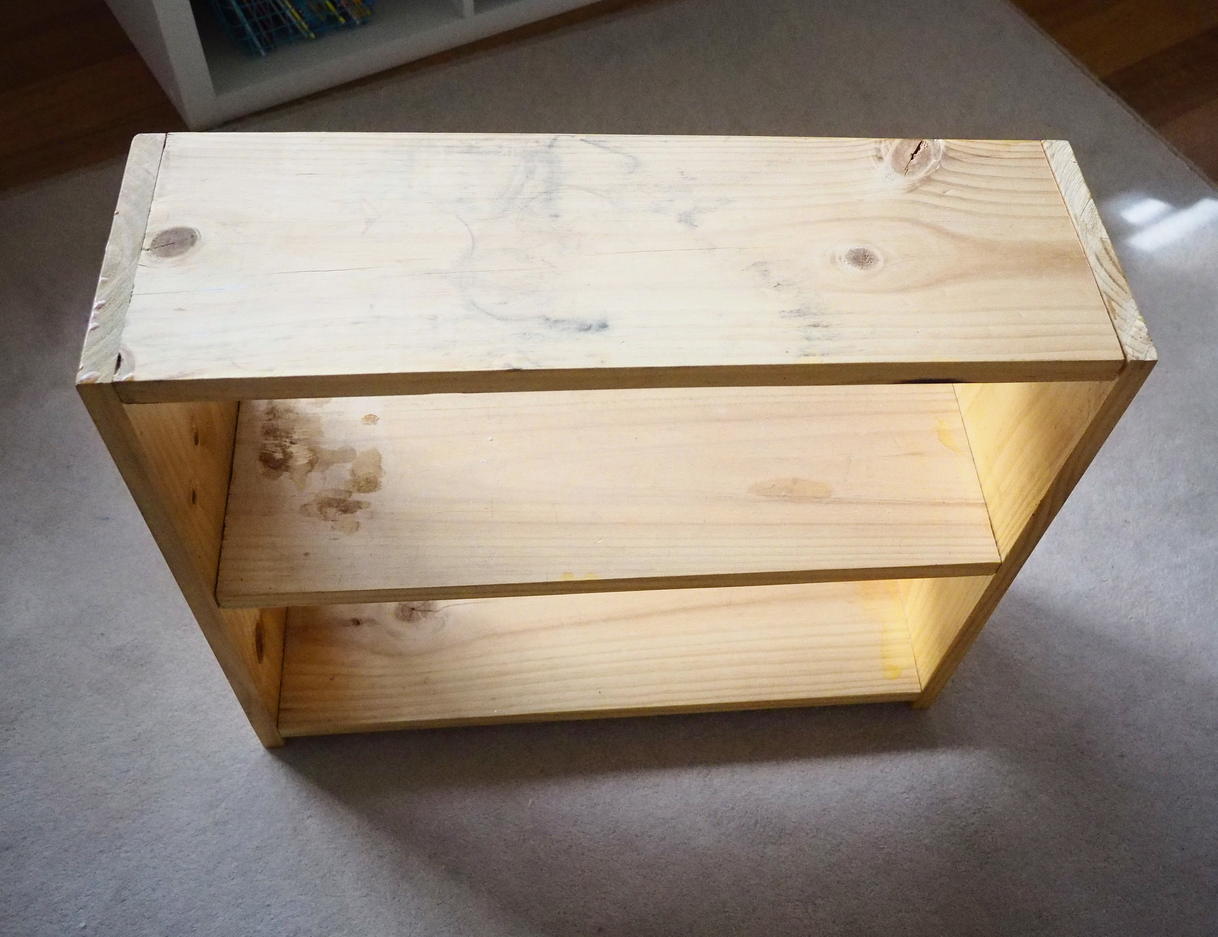 Repurposing an old shoe rack into a bedside table for a child's bedroom