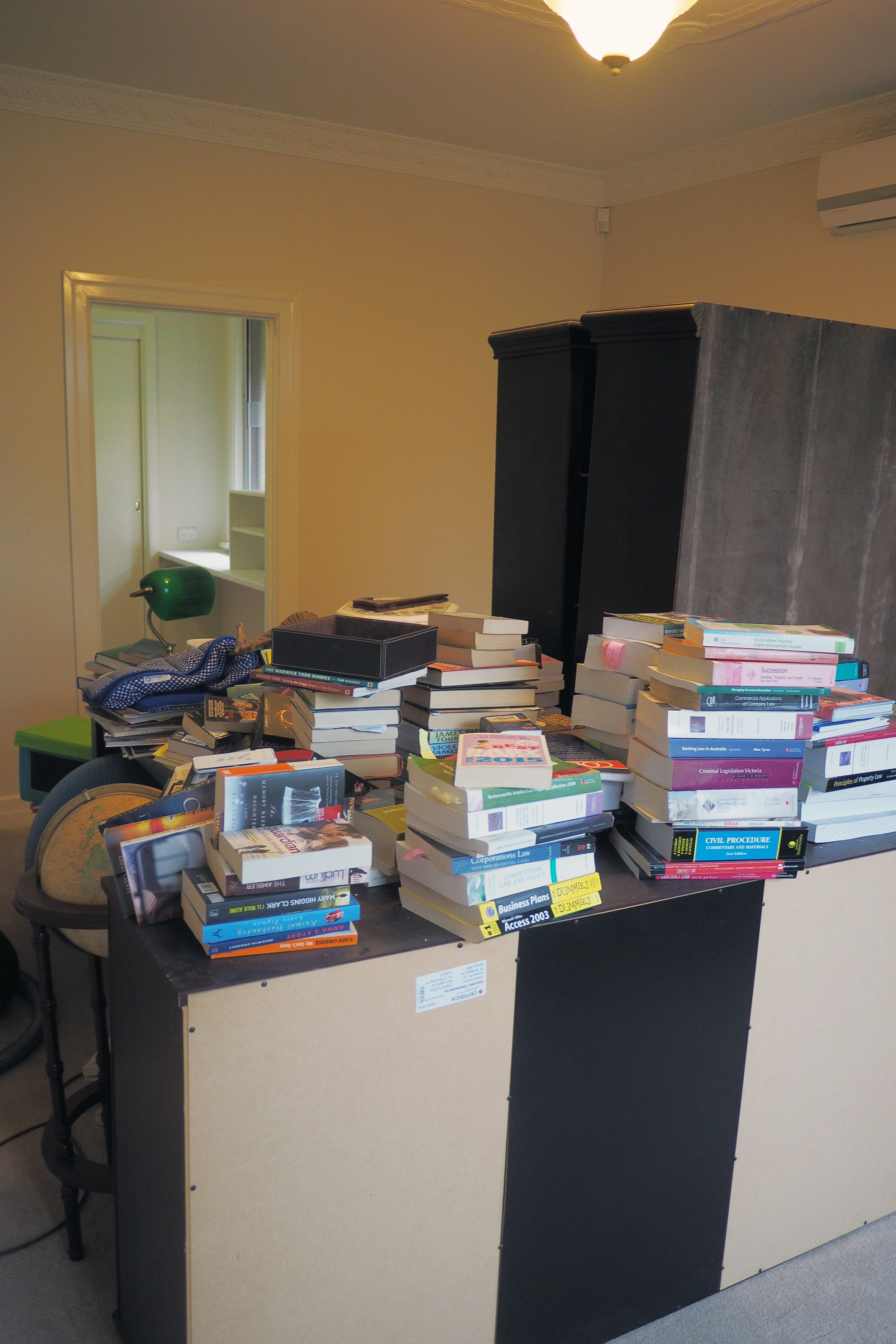 disorganised books in home office