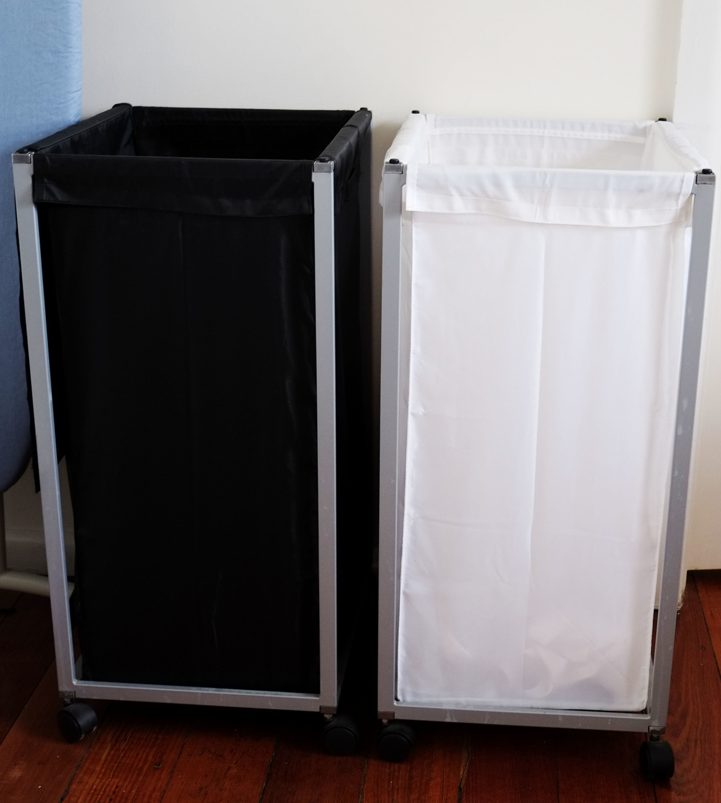 Rolling laundry hampers to separate and organise clothes in the laundry - having them on castor wheels means you can pull them over to the washing machine and then store them out of sight.