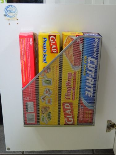 Use the back of a cupboard door as storage space for plastic wraps