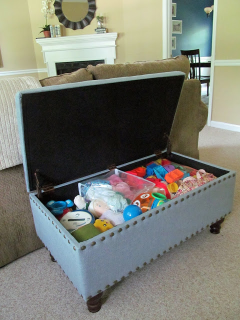Use a storage ottoman for toys in the living room