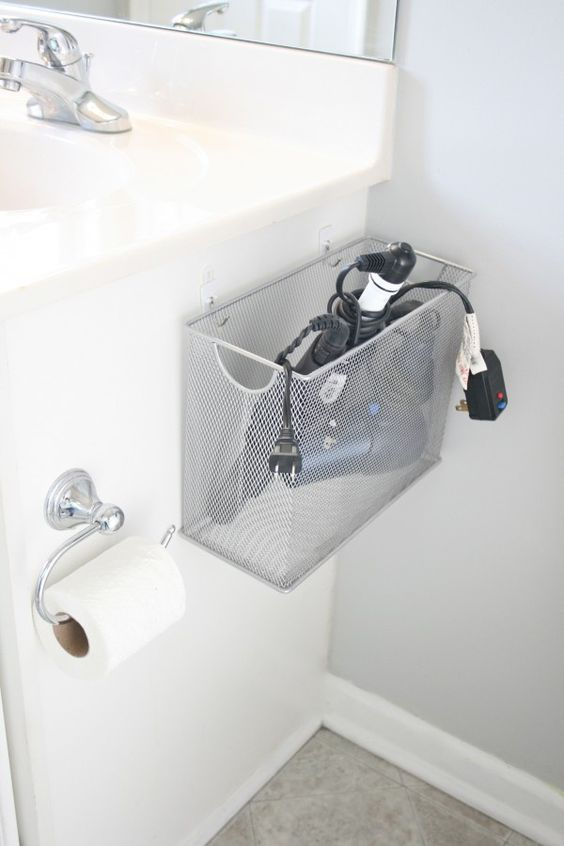 A wire basket is the perfect storage solution for holding hair appliances in the bathroom vanity