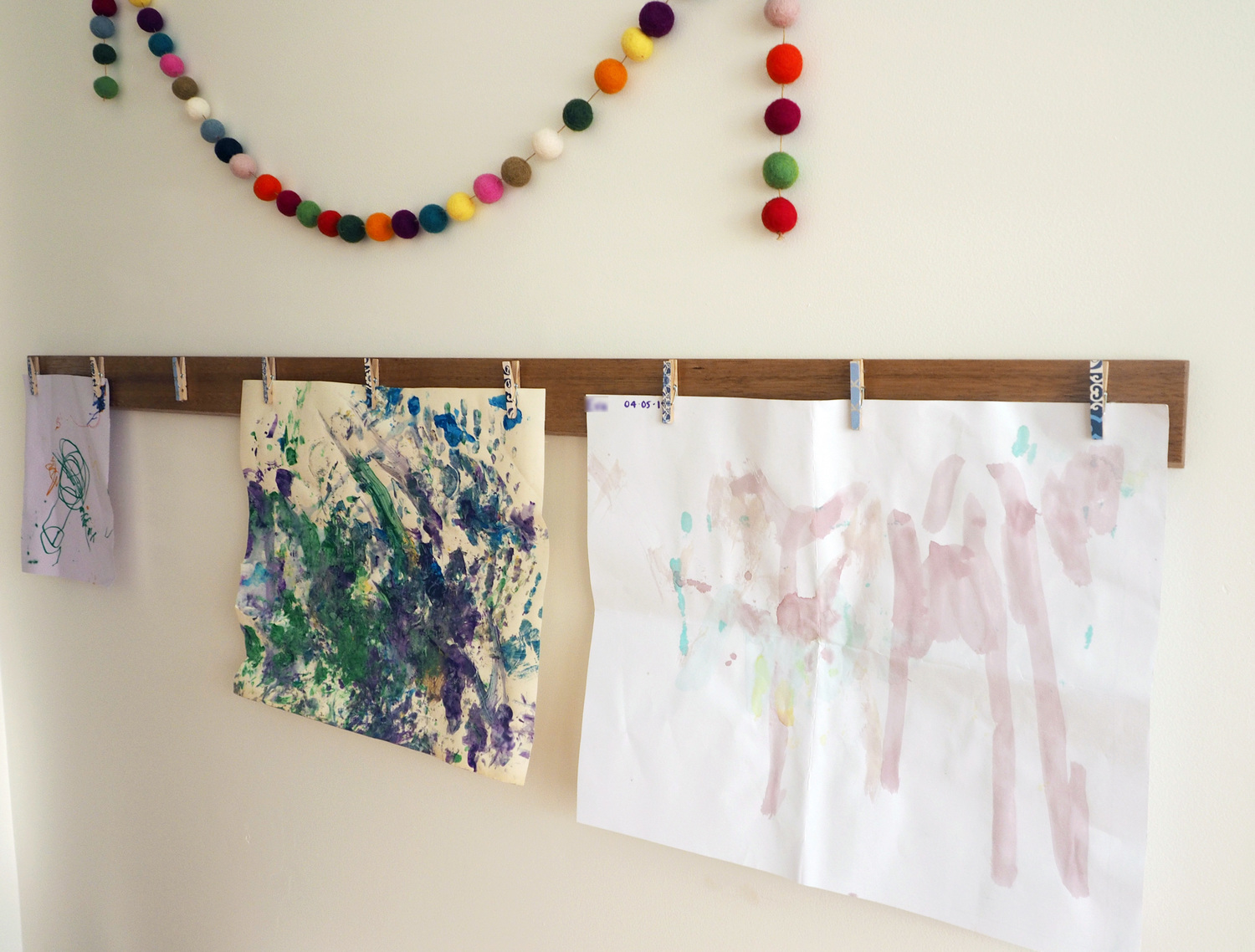 A cute artwork display in a child's bedroom