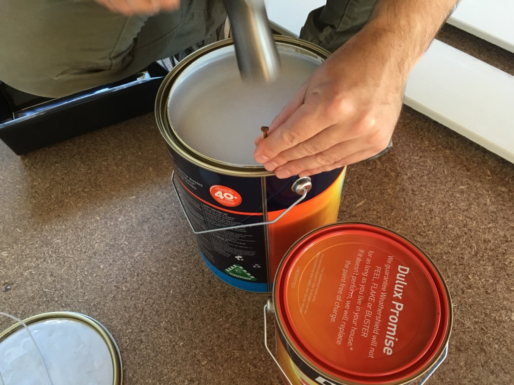 Nailing holes in the rim of the can will prevent puddles forming in the rim when pouring