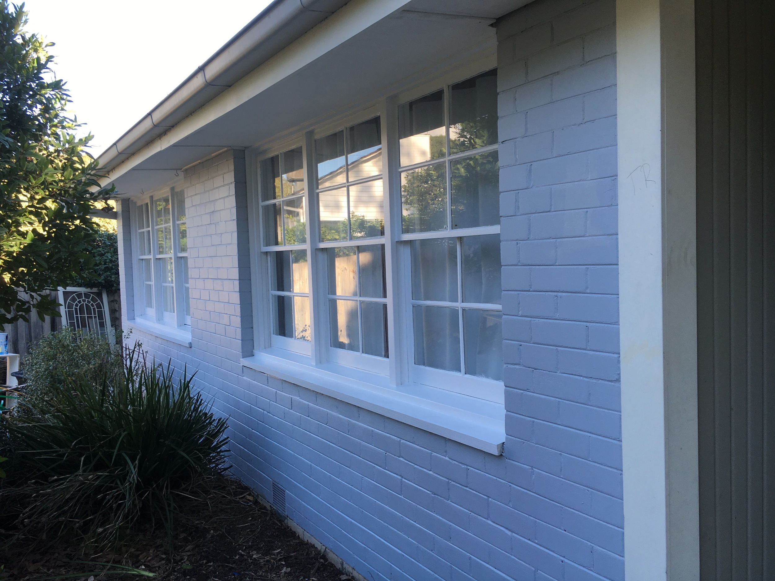 Exterior painting - use an angled brush to more easily paint fiddly window frames