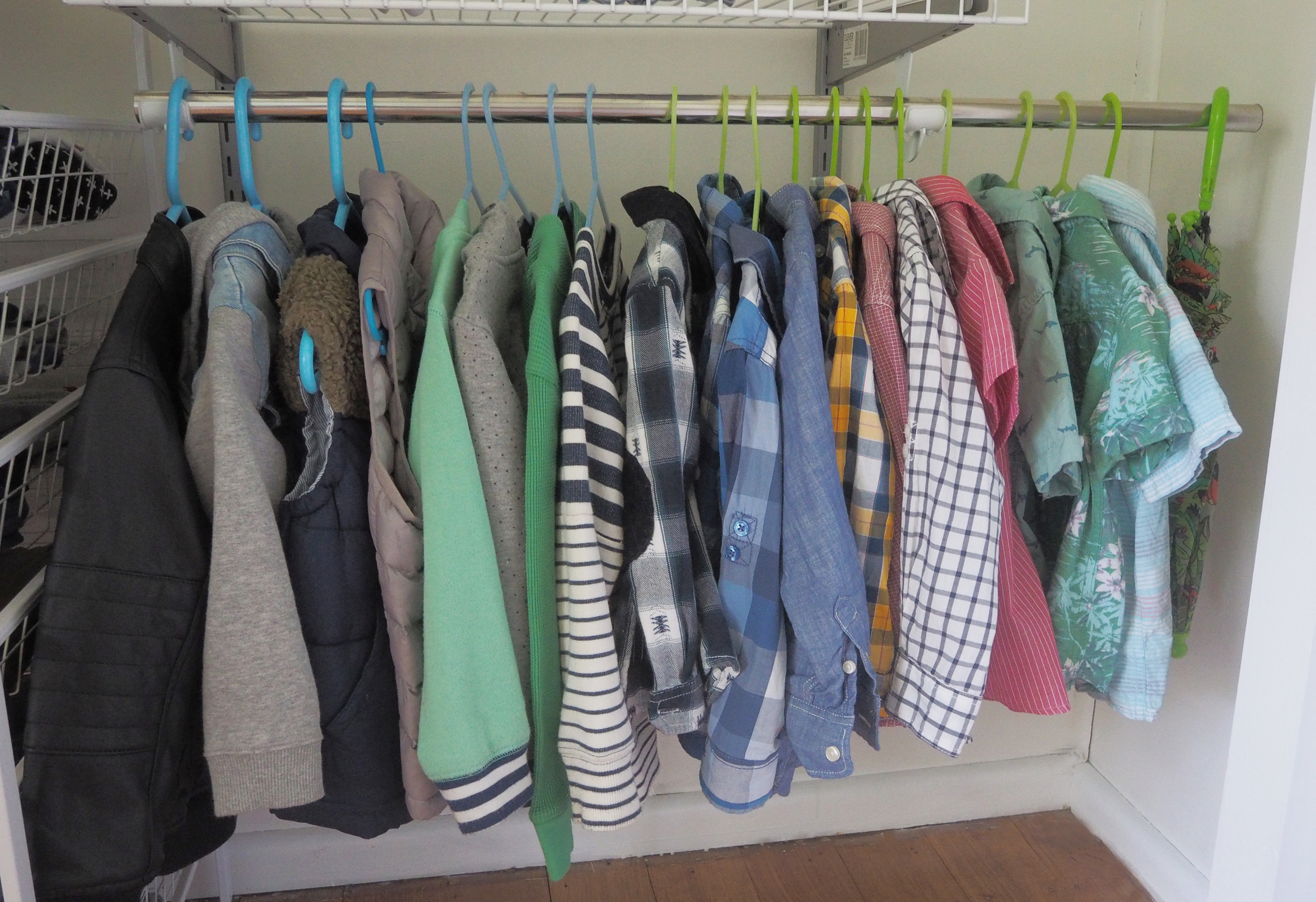 Organising the clothes in the wardrobe for our son's new bedroom - The Organised You