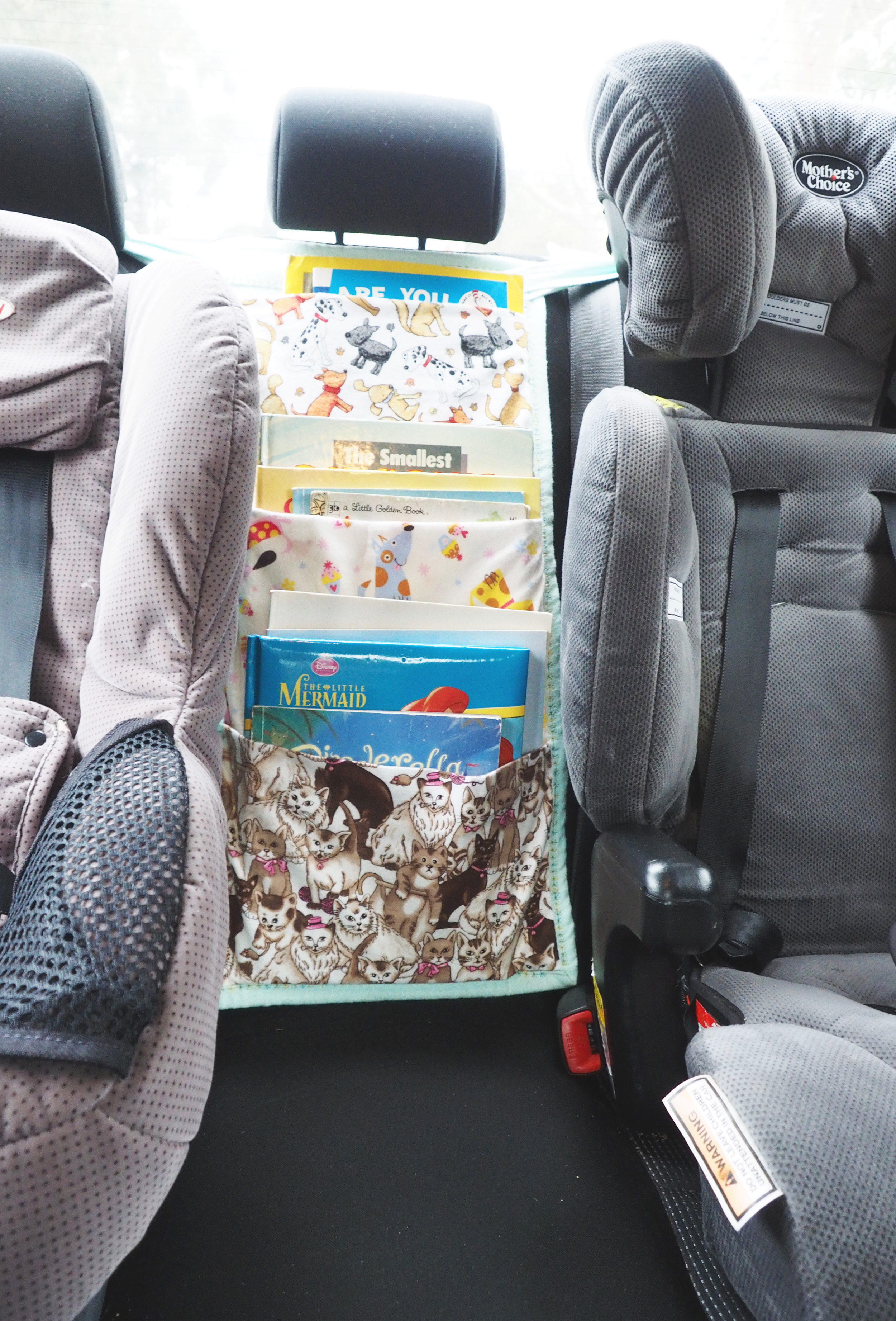 A car travel book bag to keep kids entertained in the car, and maximize storage space in the back-seat - The Organised You