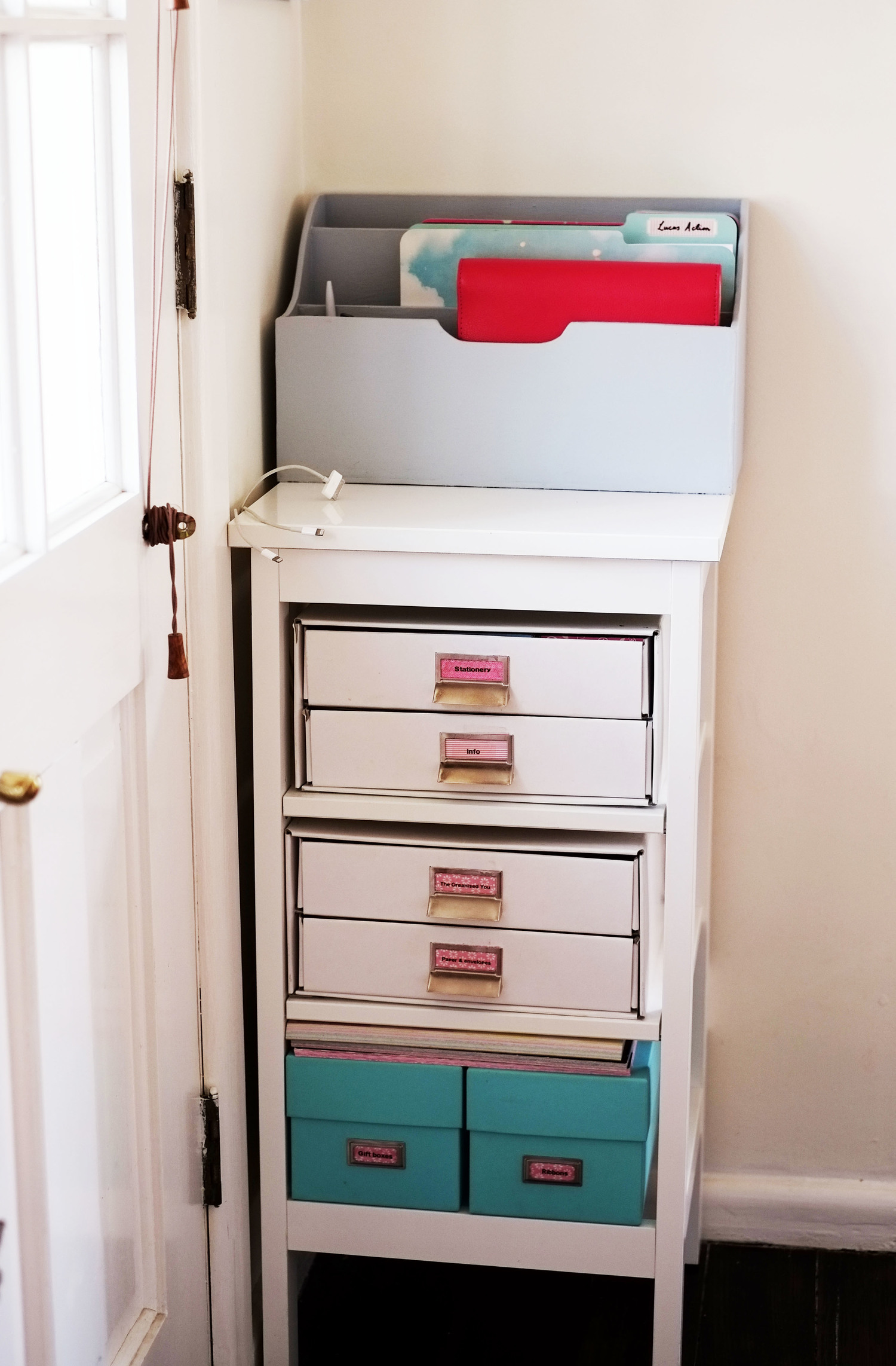 Clip cords to the side of a unit to hide cord clutter - The Organised You
