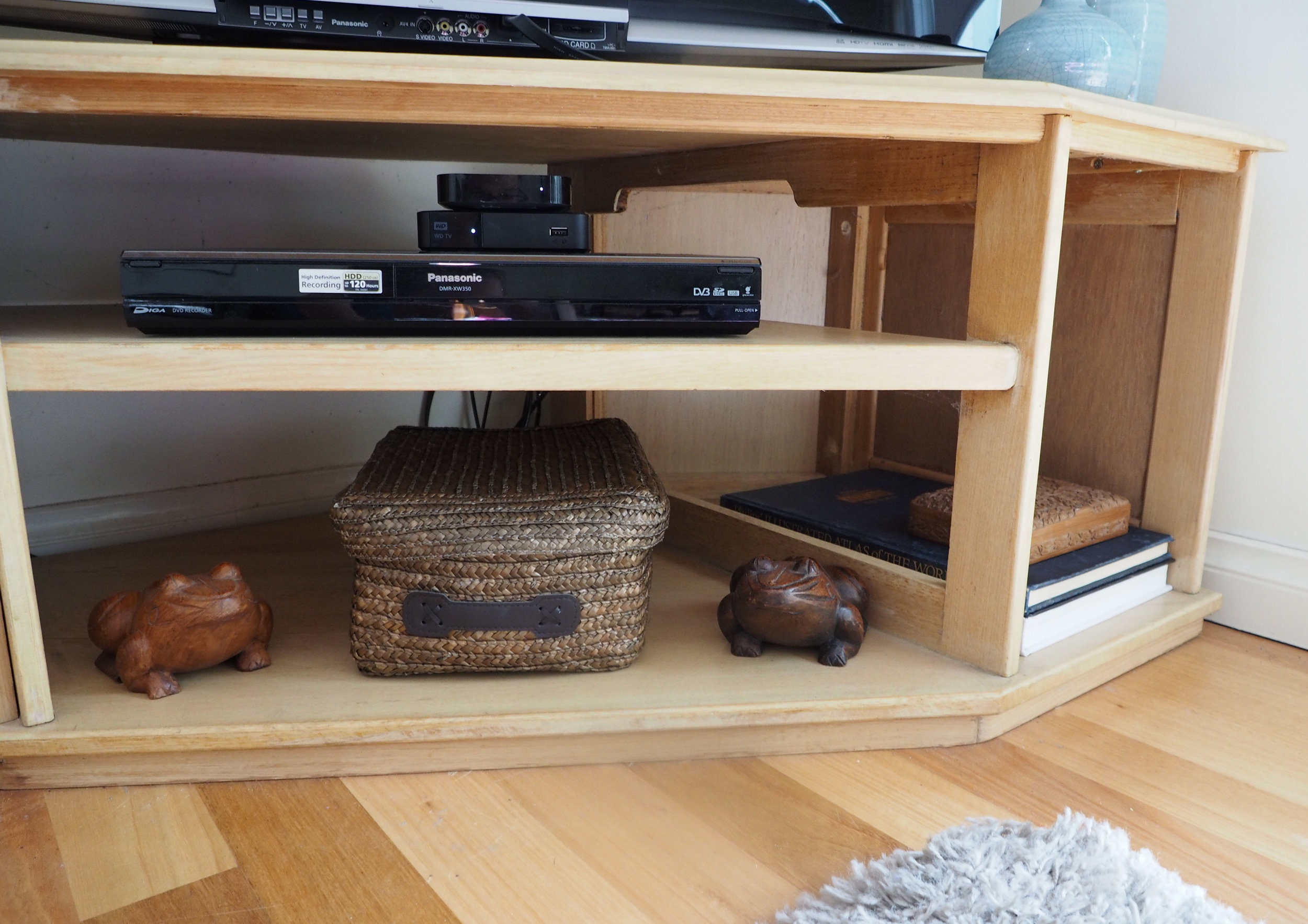 A lidded basket is a great way to conceal clutter - The Organised You
