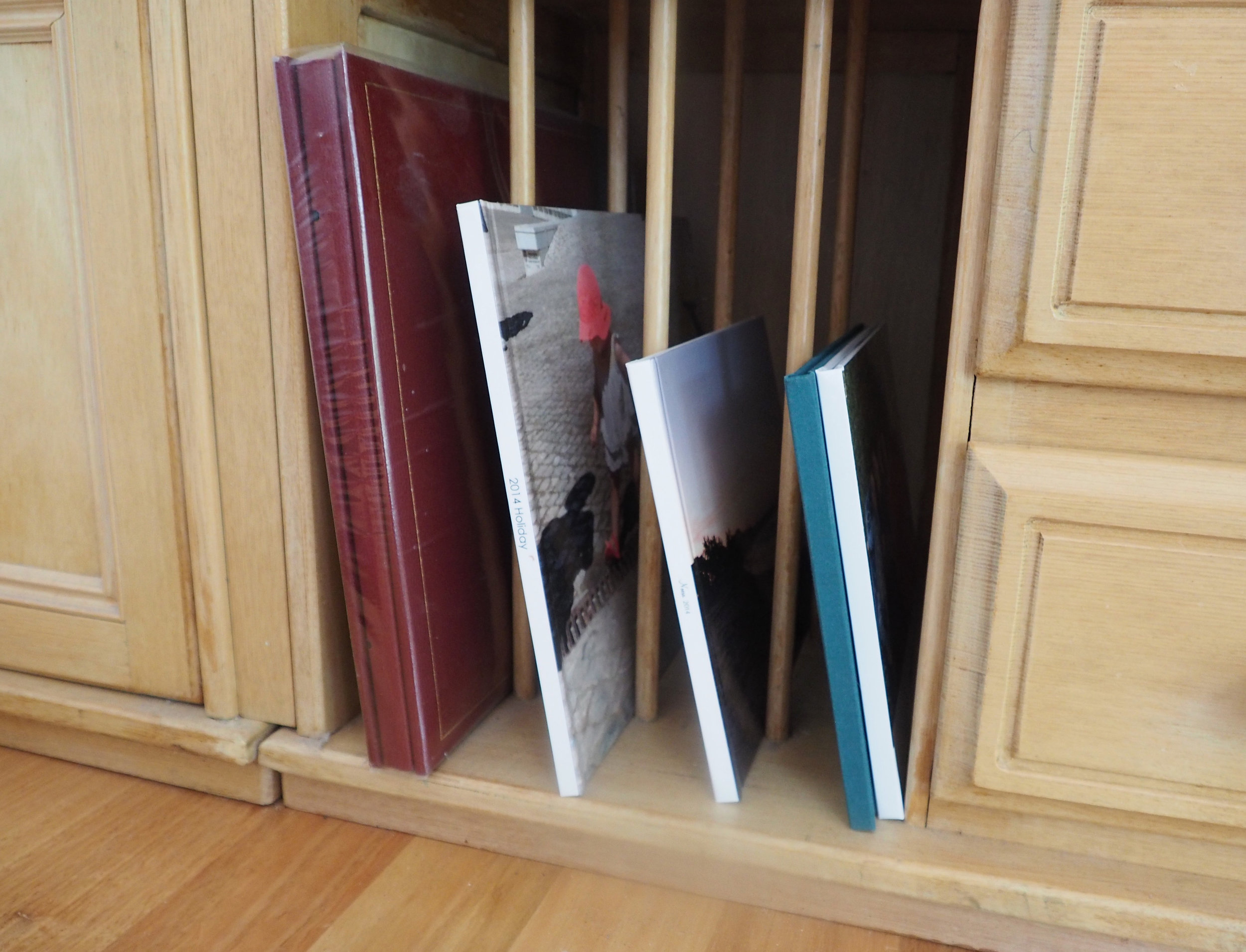 Hide warranties and manuals in a lidded basket near the TV unit - The Organised You