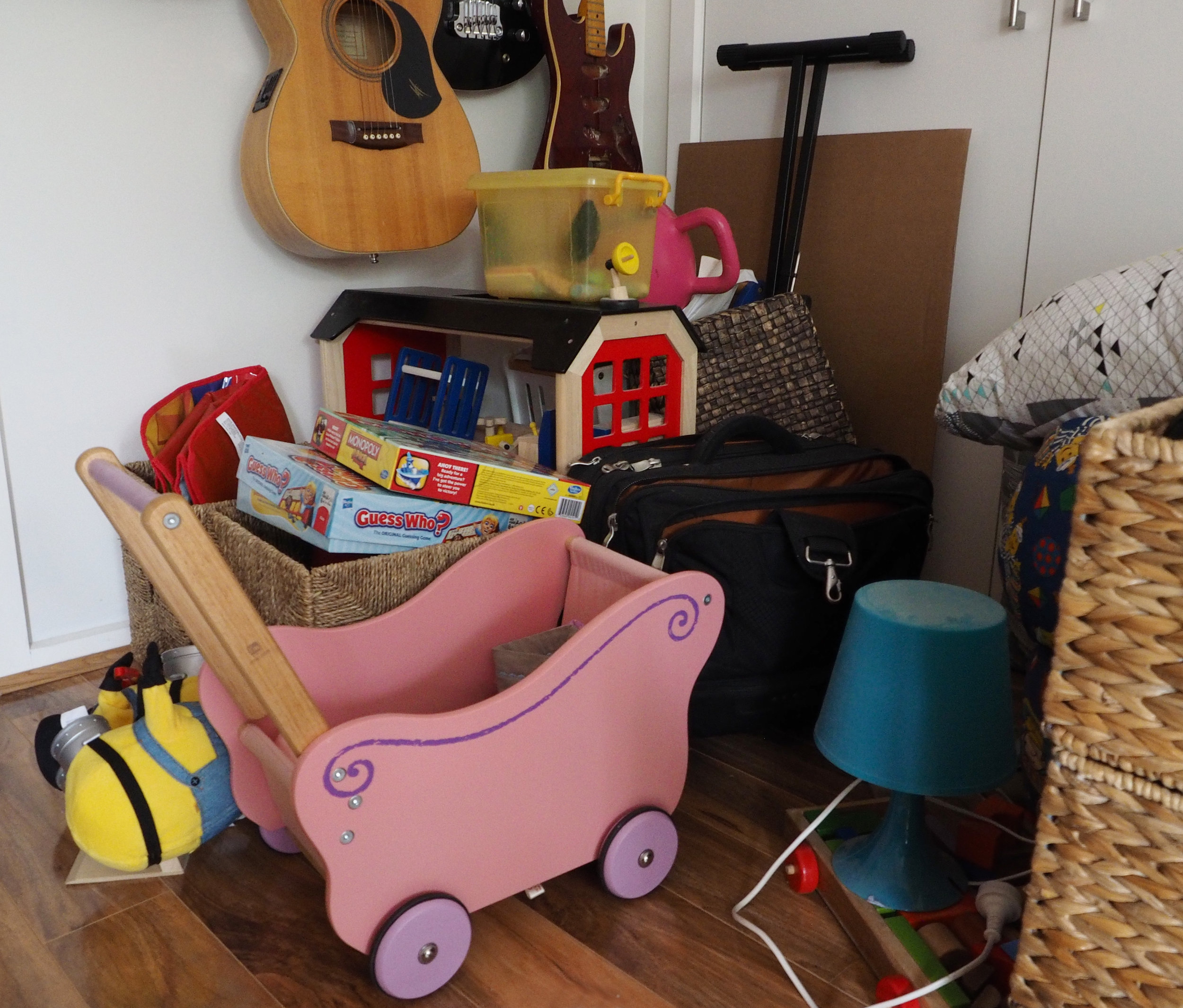 Storing larger toys elsewhere to maximize storage space in bedrooms