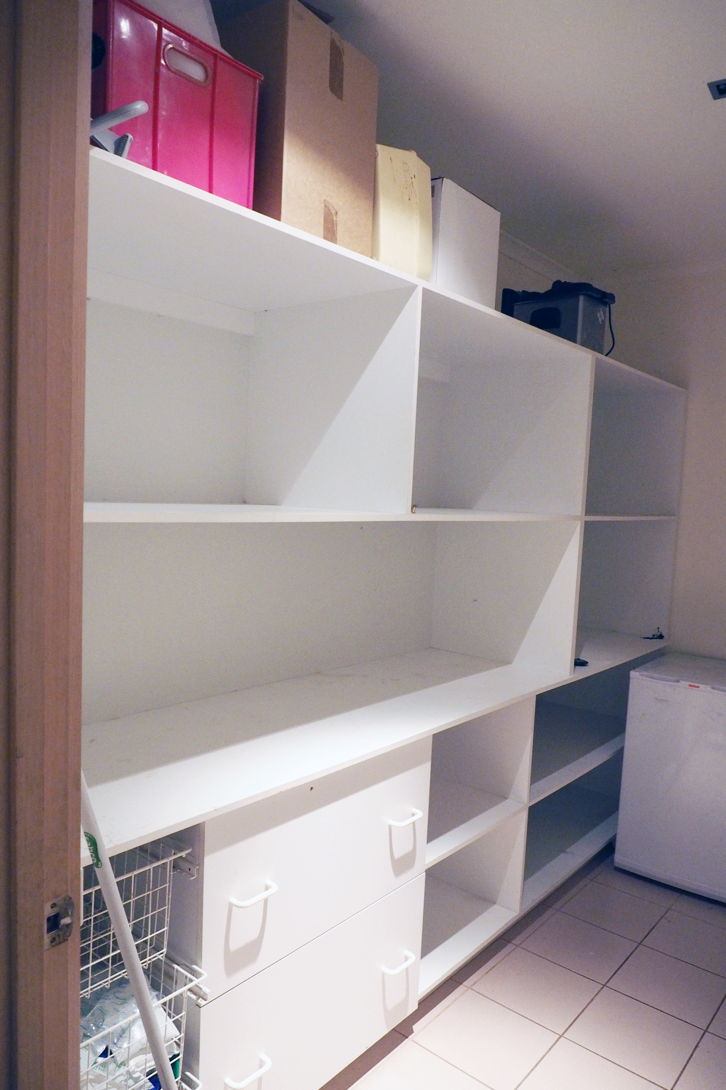 How to organise a pantry - completely empty shelves to create a blank slate {The Organised You|