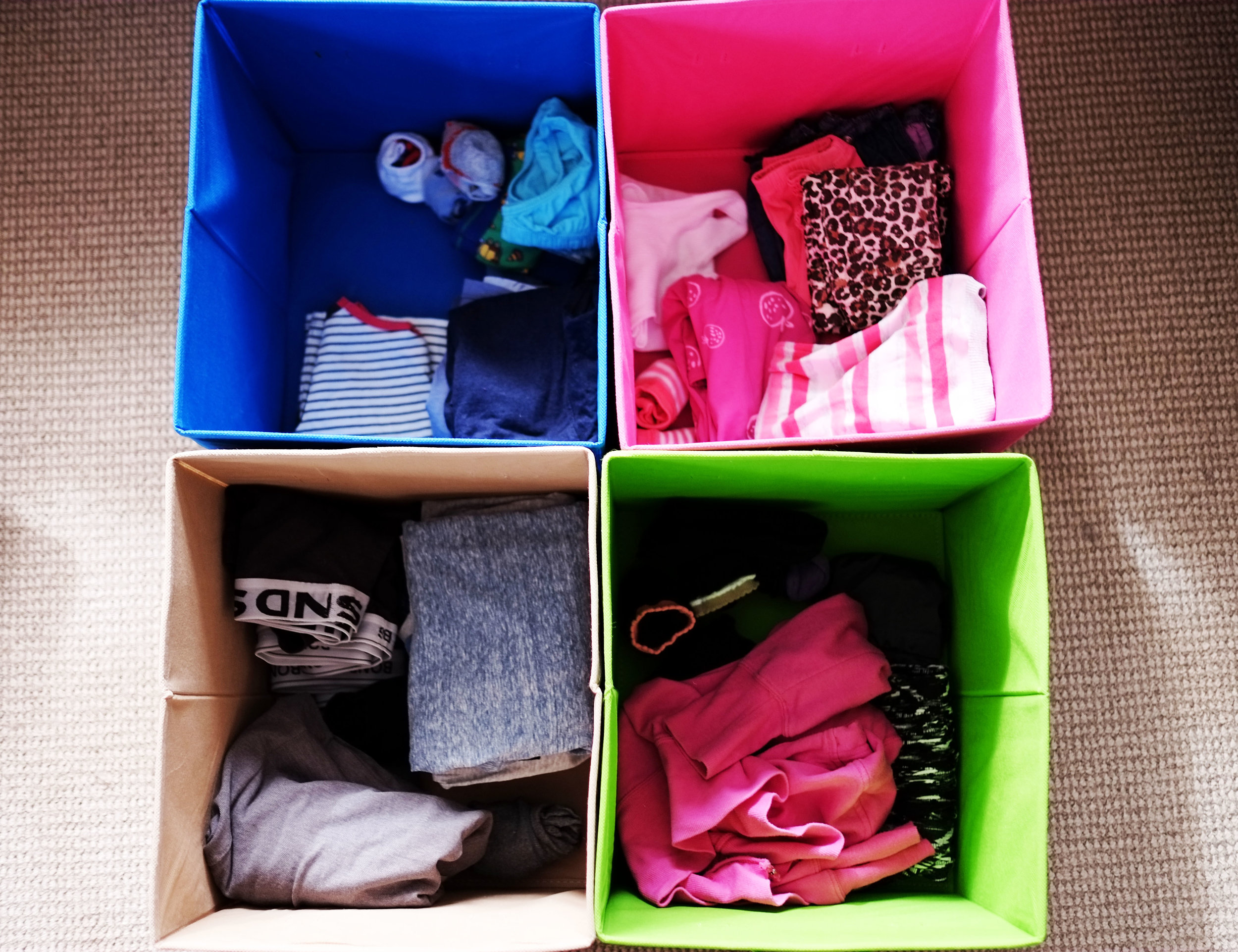 Use colour-coded baskets to sort and store clothes for each family member {The Organised You}