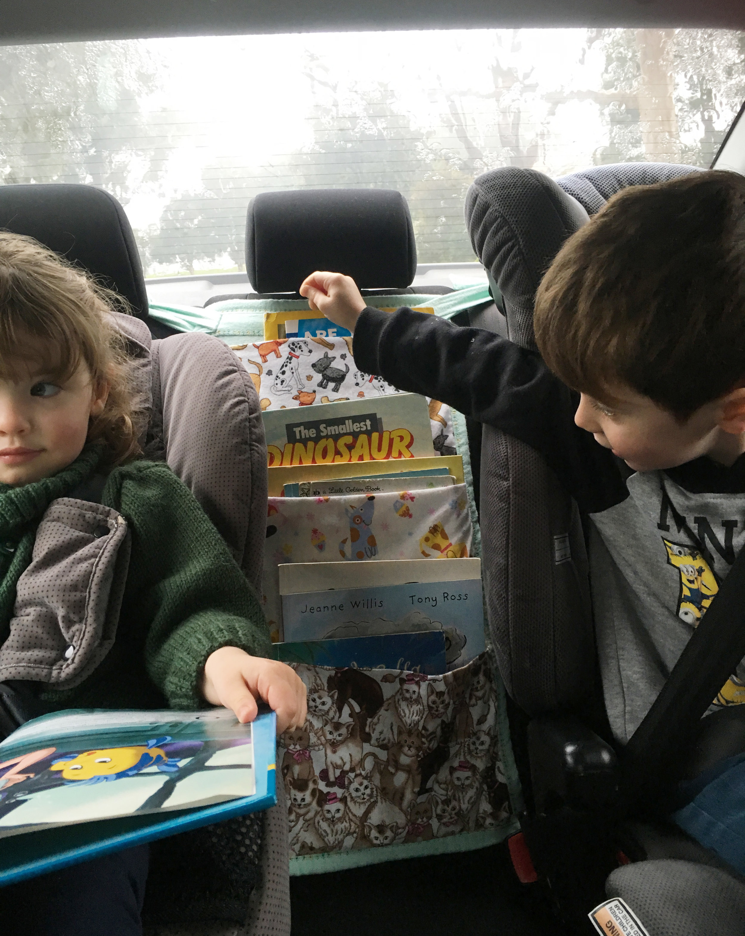 A book bag is perfect for keeping the kids entertained on long car trips, and your back seat nice and organised! {The Organised You}