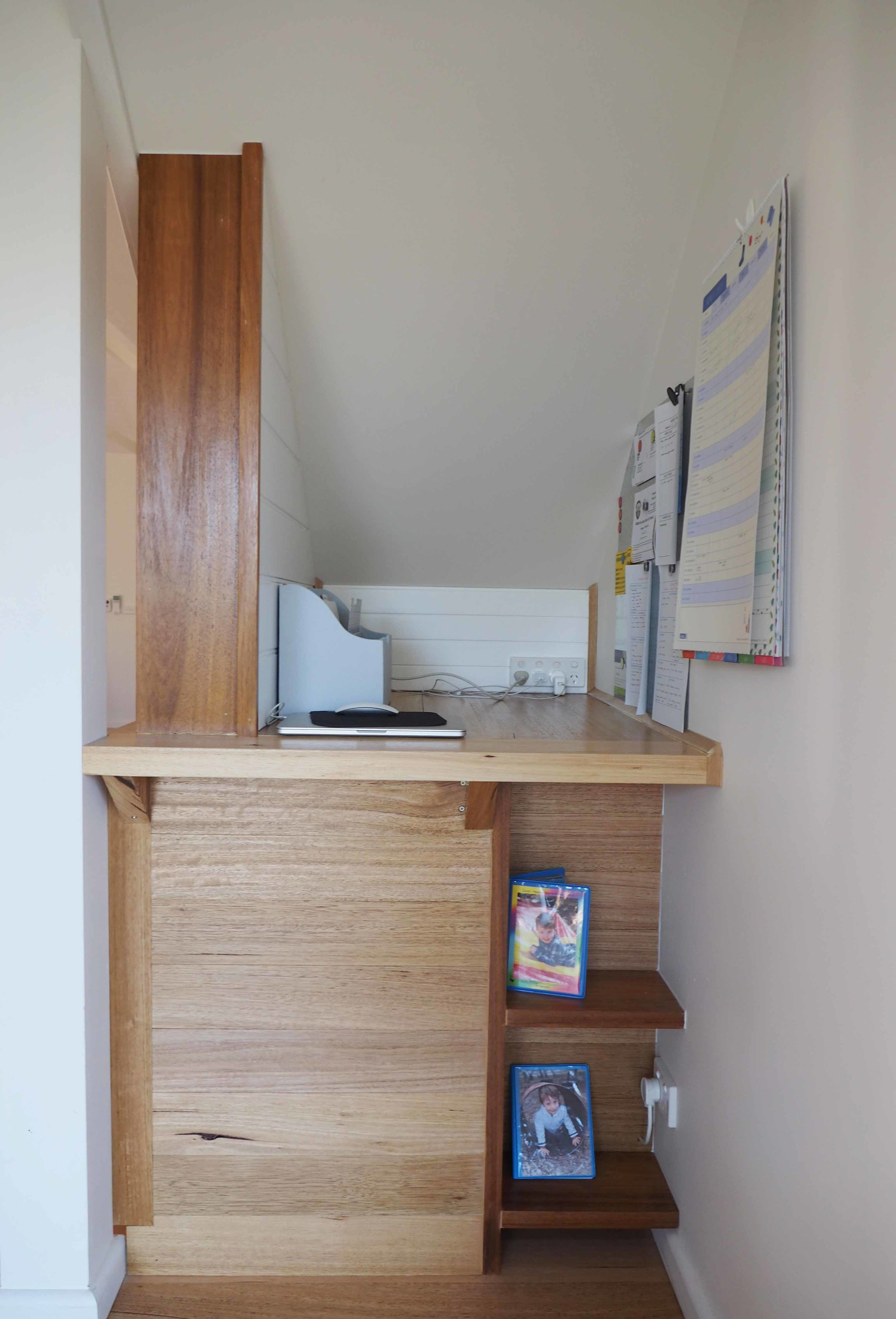 An organised family command centre using vertical space to display important information and calendar {The Organised You}