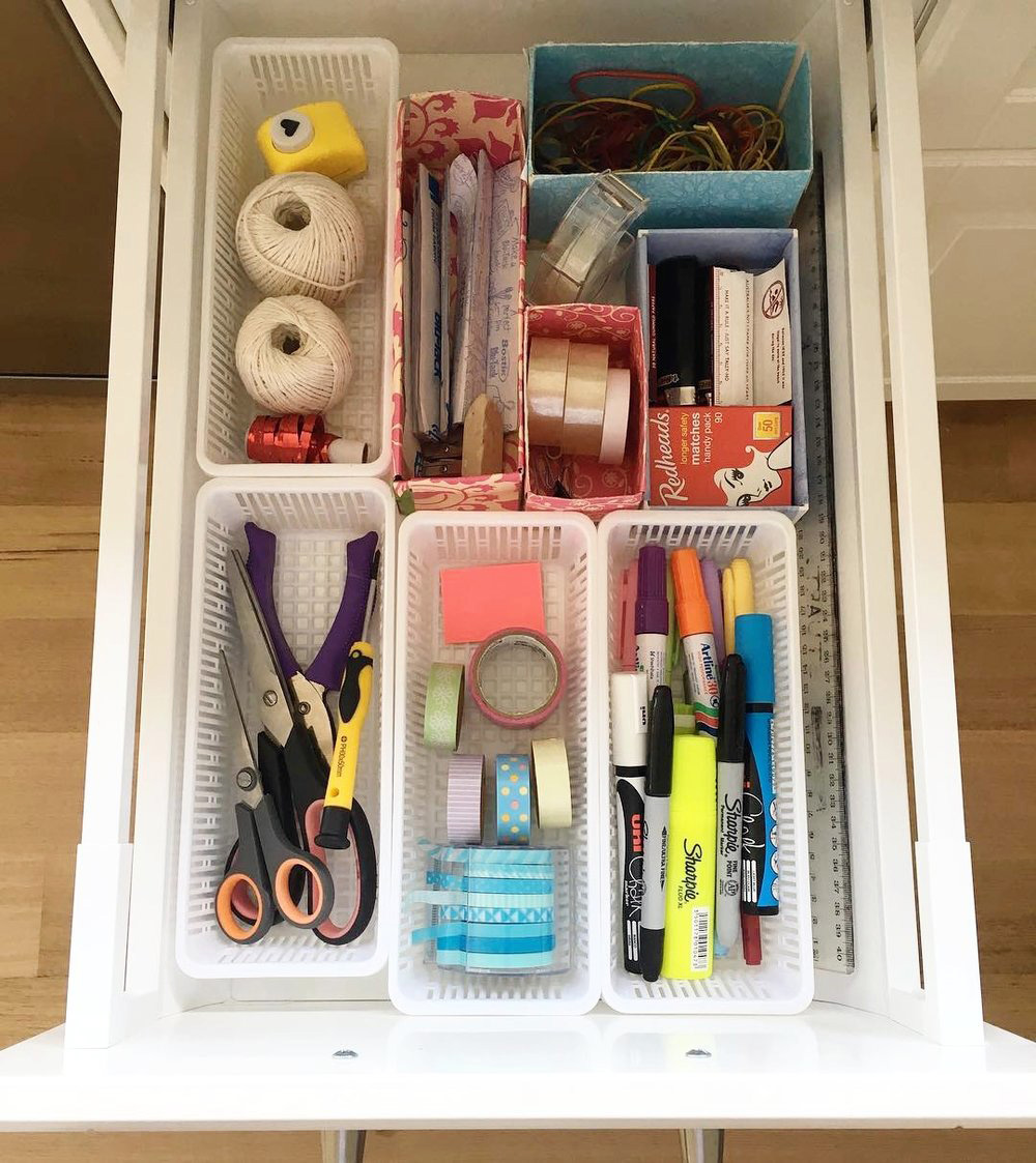 Organise a 'junk drawer' with narrow plastic baskets to categorize your stationery