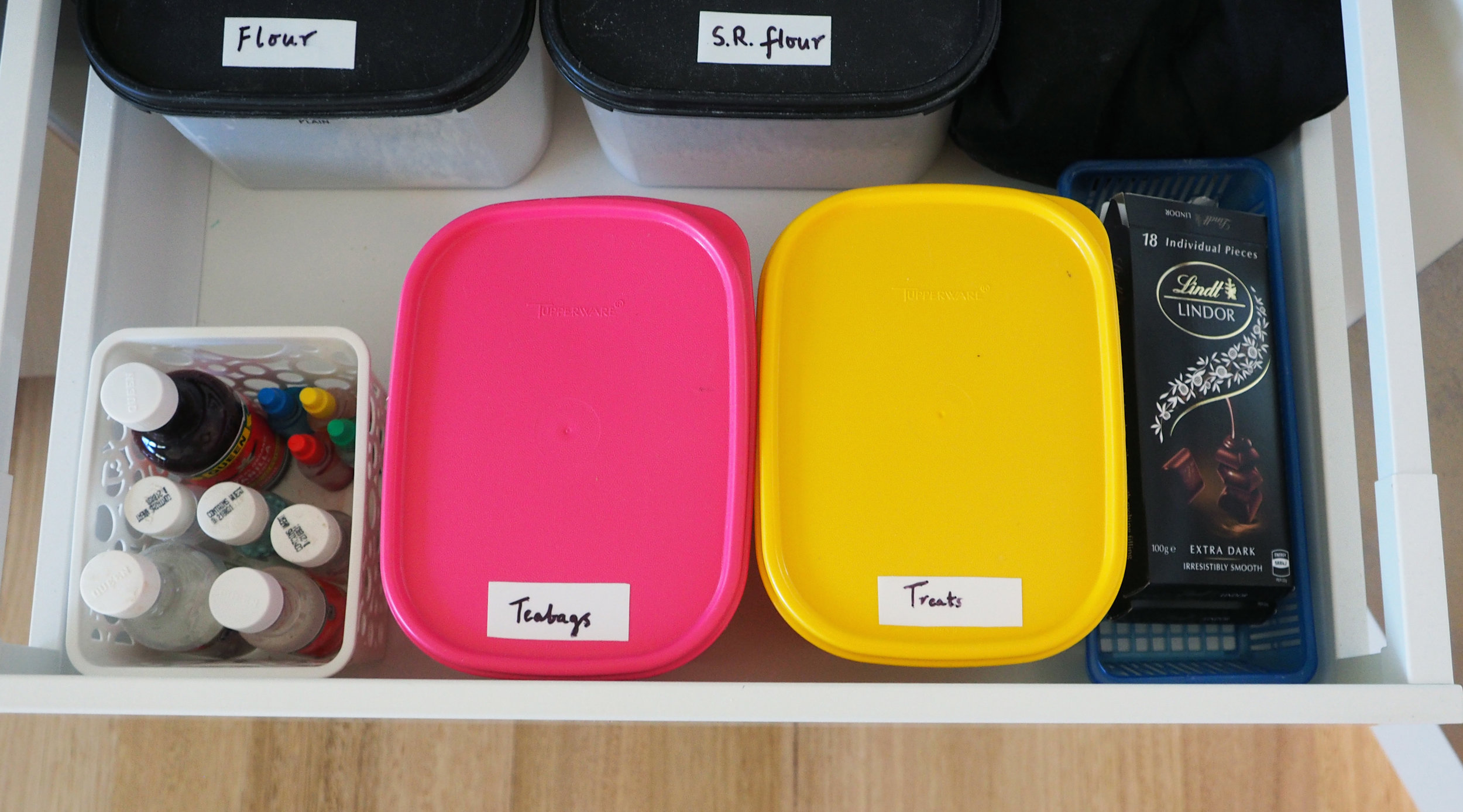 Organise loose containers in a pantry using a small basket