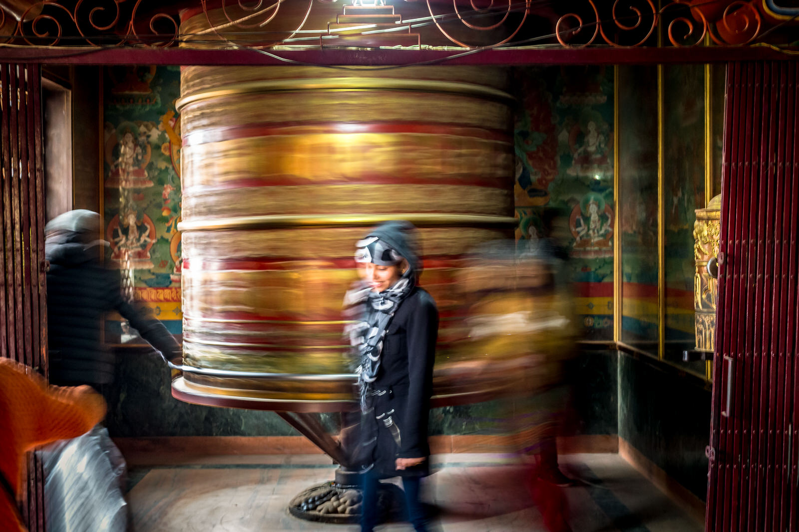 A giant prayer wheel being spun. Traditionally, the mantra Om Mani Padme Hum is written in Sanskrit on the outside.