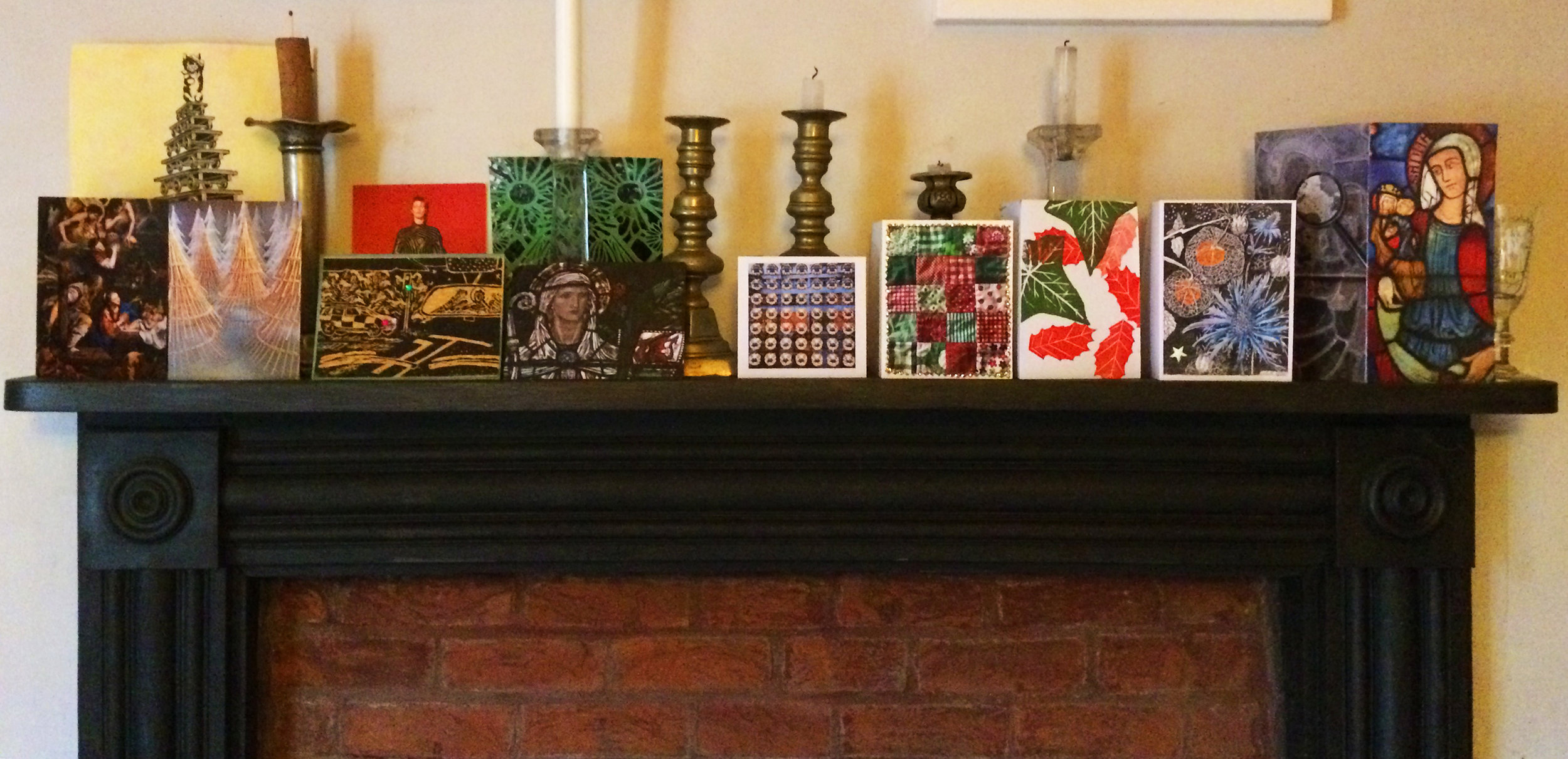 My favourite cards on the mantlepiece, particularly the patterned ones in the middle with seasonal colours and glitter! Click to enlarge.