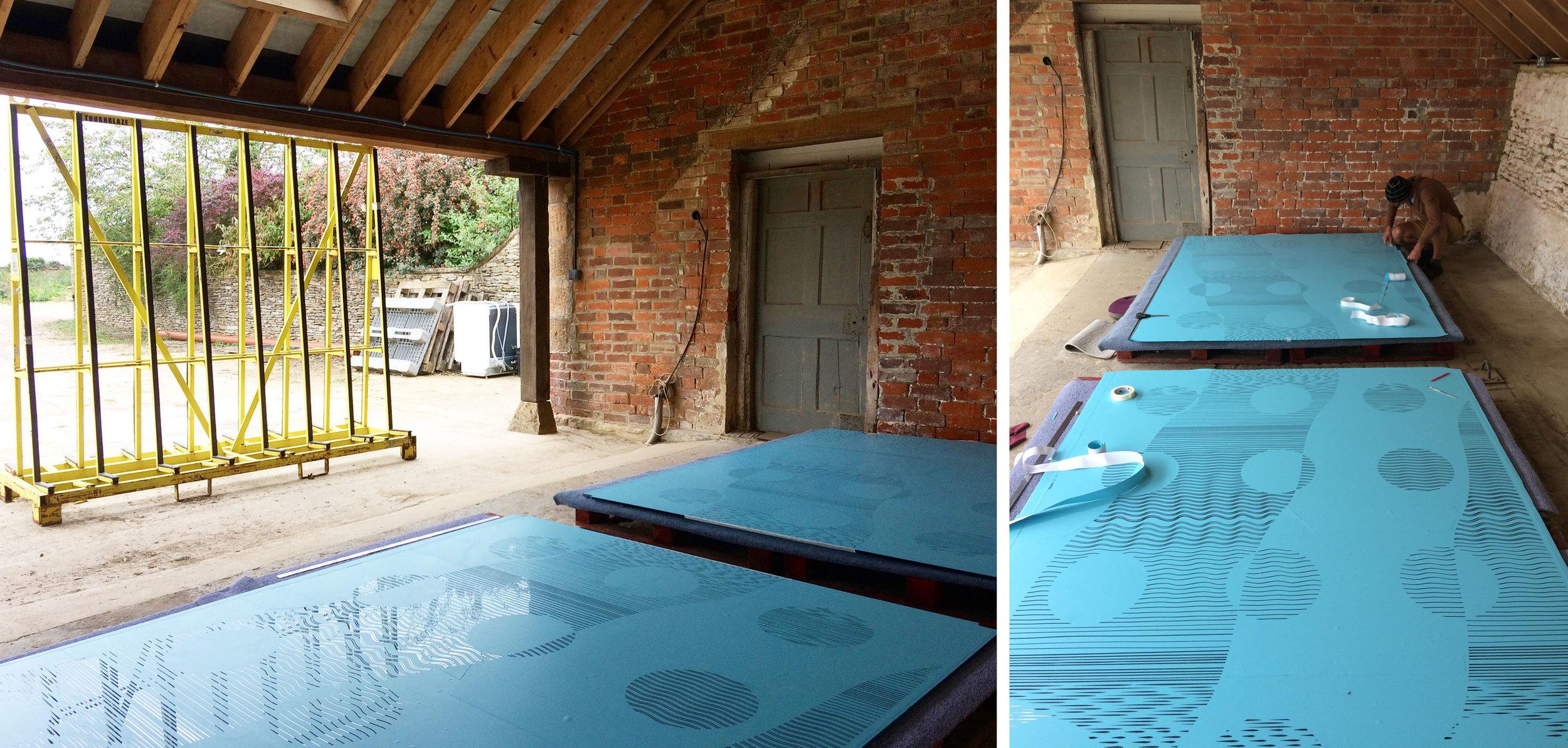 Glass doors covered with vinyl stencils under a carport near Malmesbury.